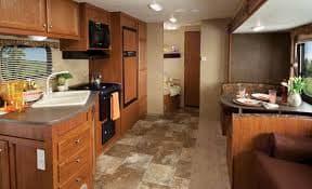 entrance facing back ,bunks and washroom with shower.. Jayco Camper Trailer- Swift 2014
