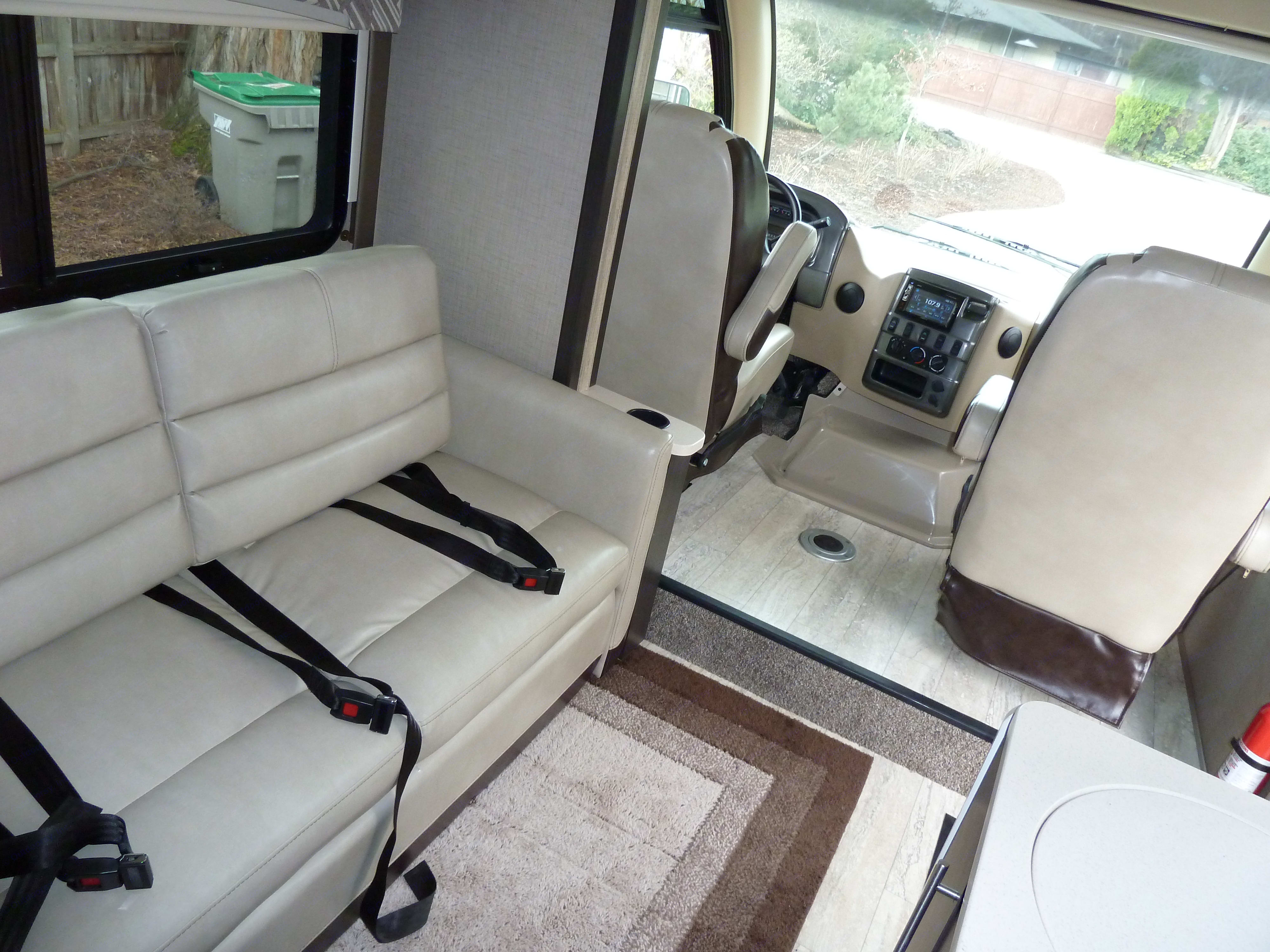 This is the set up for when you are driving. 3 sets of seatbelts on the sofa and the 2 captain chairs in the front.. Thor Motor Coach Axis 2018