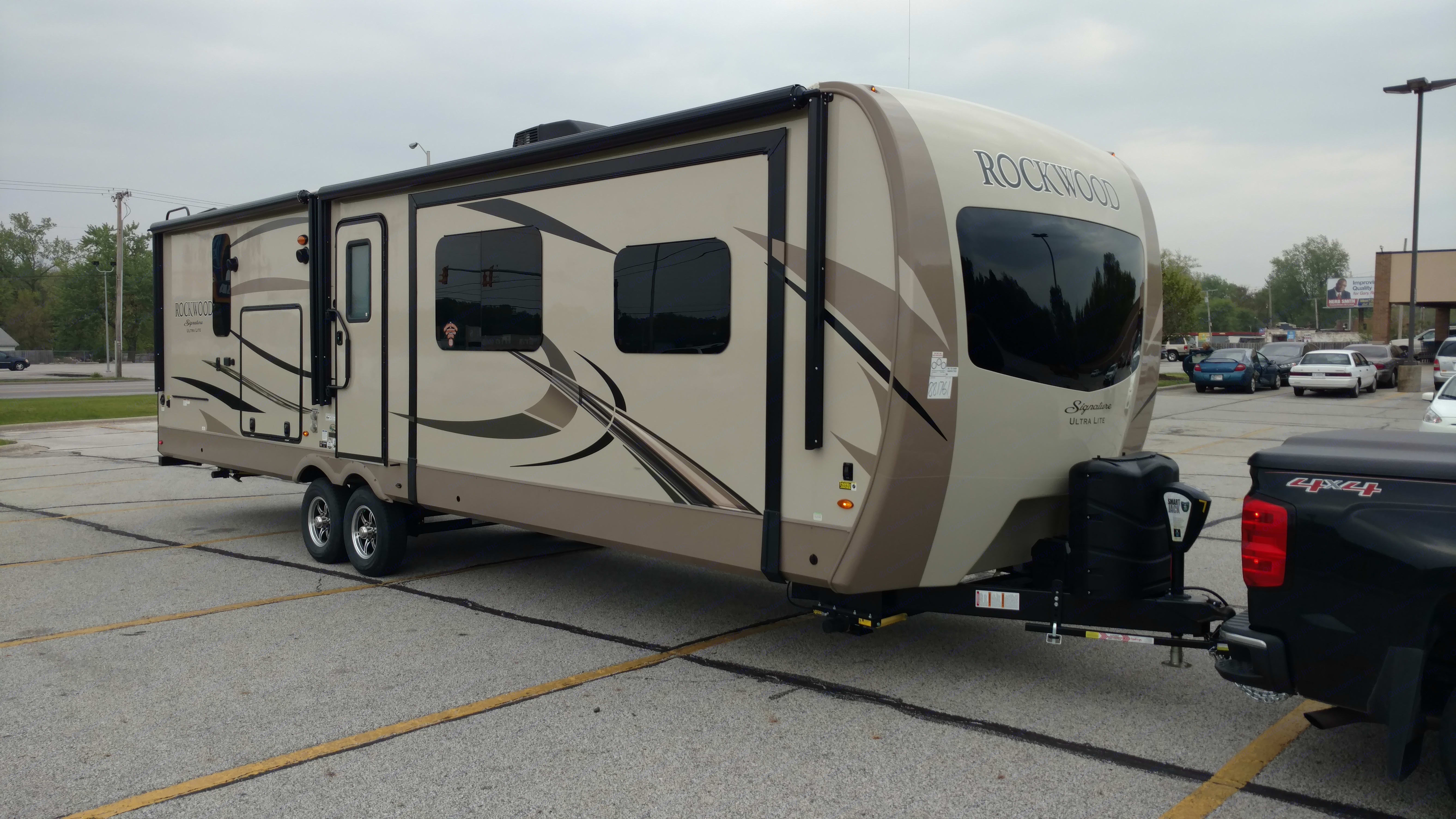 RT side showing the one slide and two awnings and out side kitchen. Forest River Rockwood Signature Ultra 2019