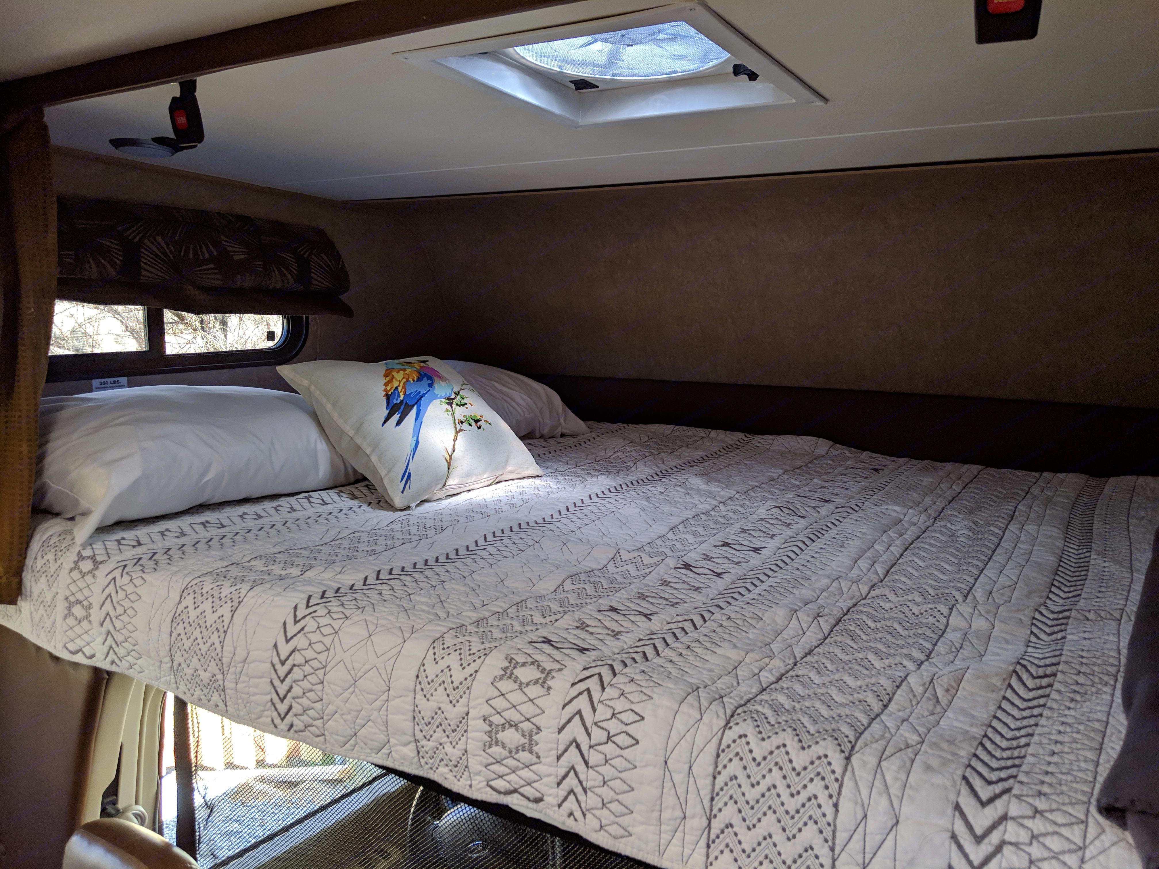 Cabover bed with linens. Coachmen Leprechaun 2016
