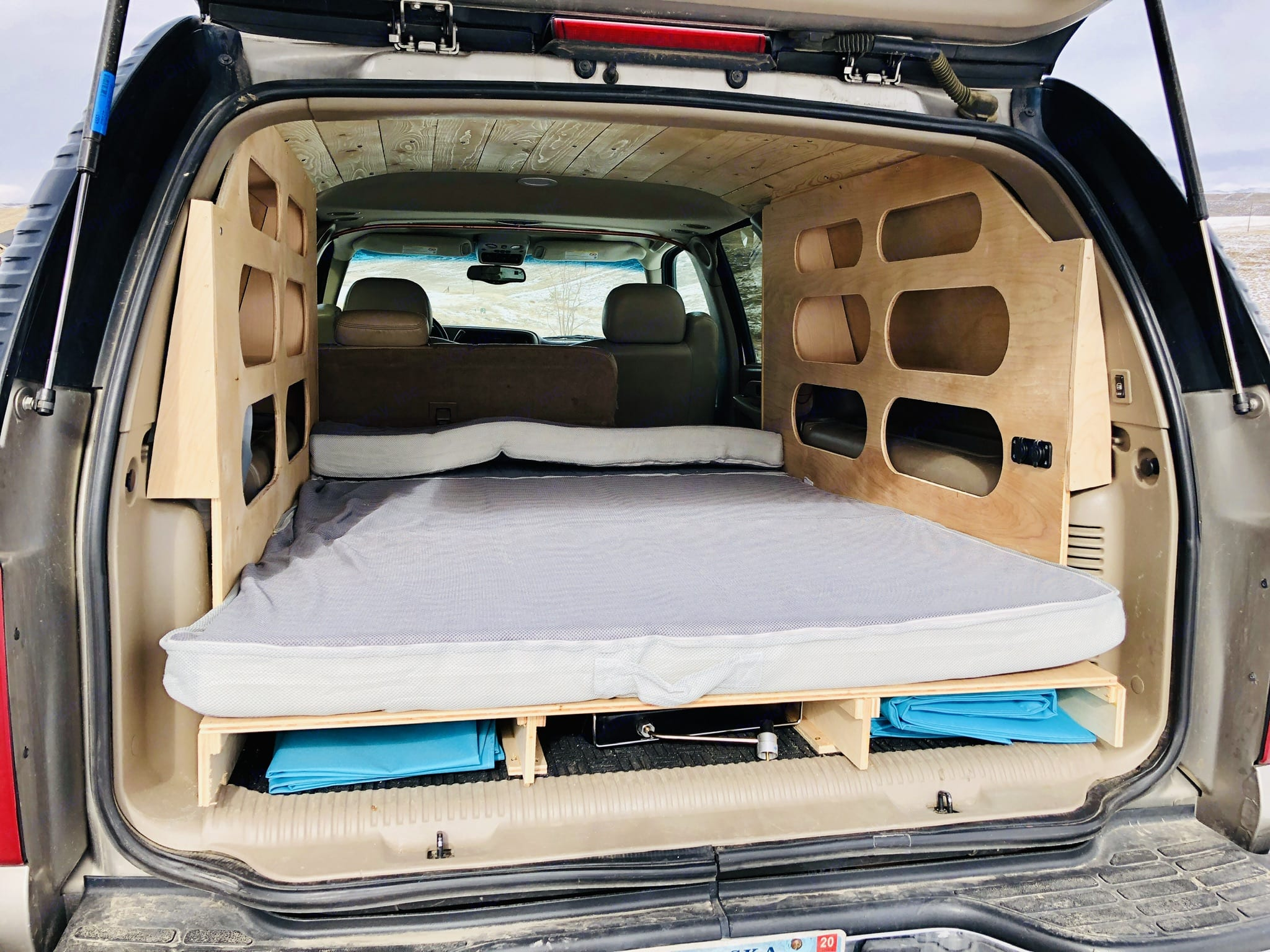 Interior shot with bed, linens will be provided . Chevrolet Suburban Overland 2000