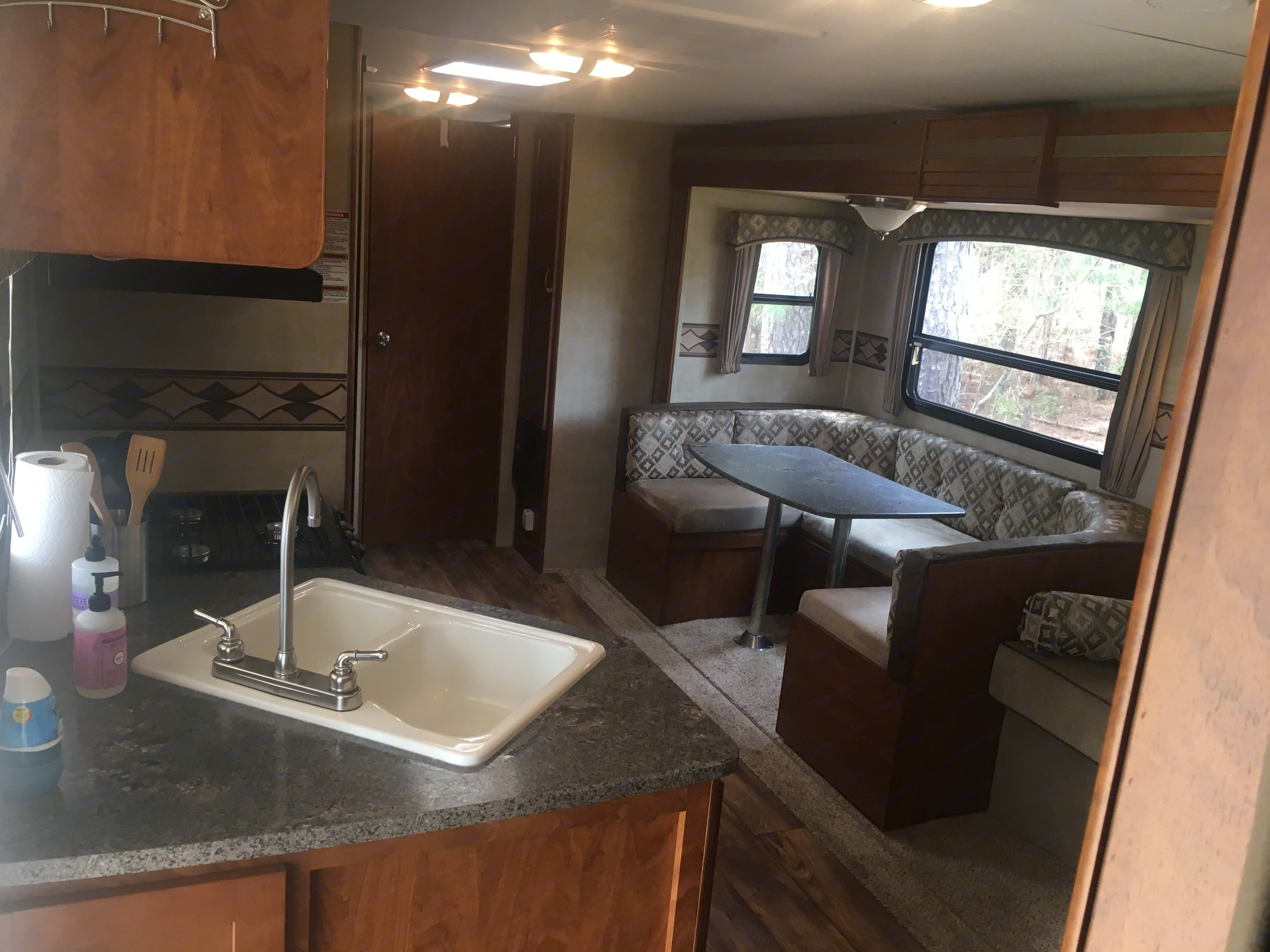 On the left you have the kitchen, fridge, closet, and bunks. The Bathroom is in the rear. On the right is the large slideout with a U shaped dinette and a sofa that turns into a bed.  . Keystone Passport 2014