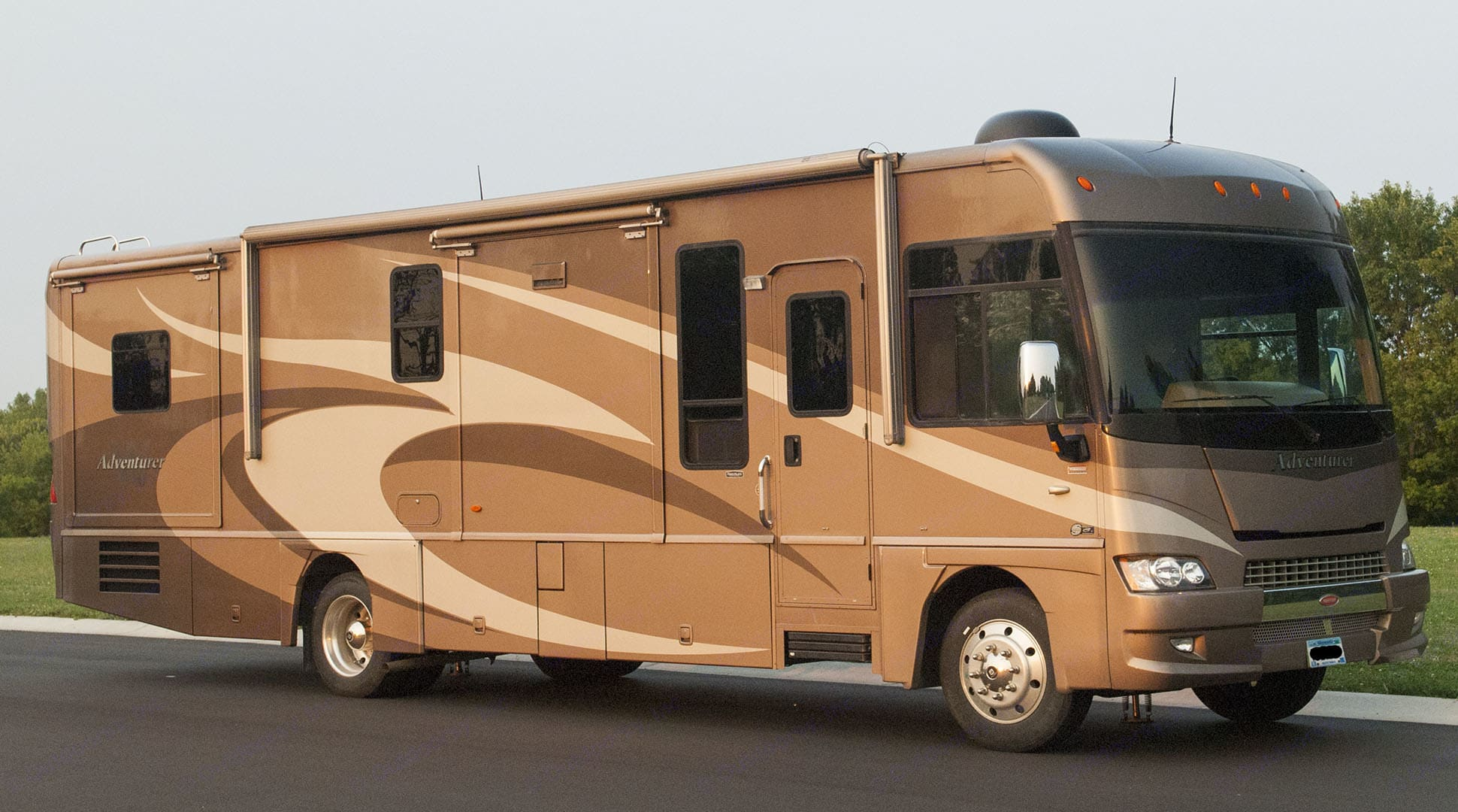 Passenger Side.  Note Large Electrically Operated Awning.  Right Turn Camera Just Under The Mirror.  Rear Camera On Back Of RV.. Winnebago Adventurer 2008
