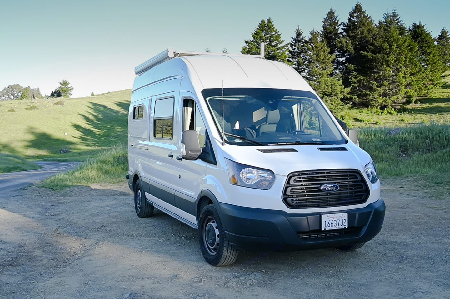 passenger side with opening bed and sliding door windows. Ford Transit 350 High Roof 2018