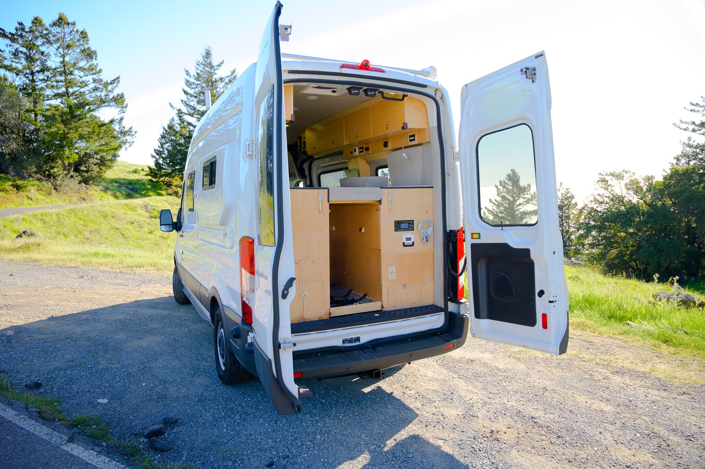 Rear entrance with steps to get into bed from rear and a 4' pull out tray for larger toys and storage. Ford Transit 350 High Roof 2018