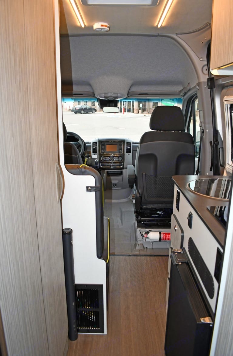 View of kitchen looking forward. Front seats swivel to face backwards. . Winnebago Mercedes Sprinter 2020