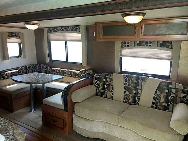 Slide out includes the kitchen table and the sofa.. Gulf Stream Conquest 2014