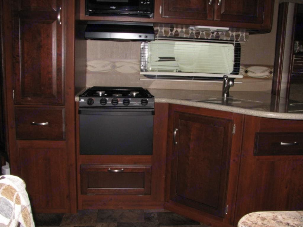 Double Sink, Stove and Microwave.  Cutlery drawer(s) to the left and right.. Keystone Outback 2014