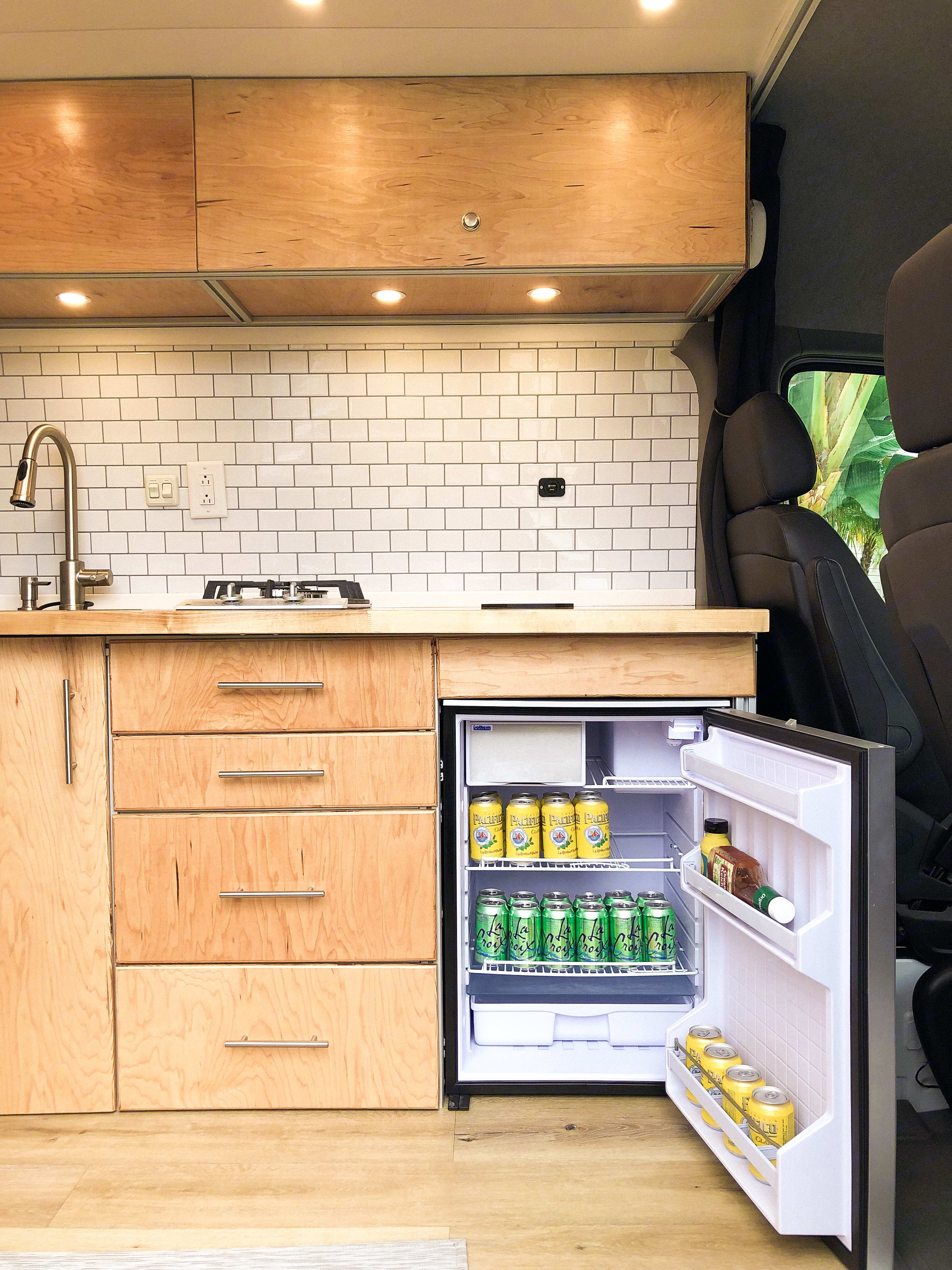 Stainless steel refrigerator with lots of storage and freezer. . Mercedes Benz Sprinter 2017