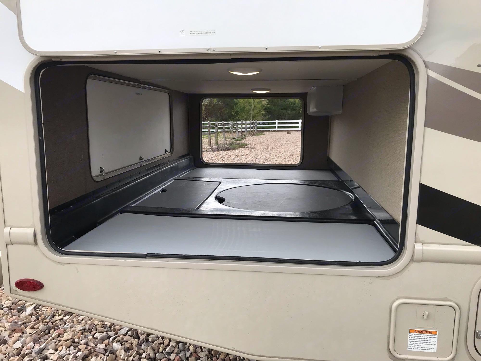 Plenty of exterior storage. Thor Motor Coach Four Winds 2018