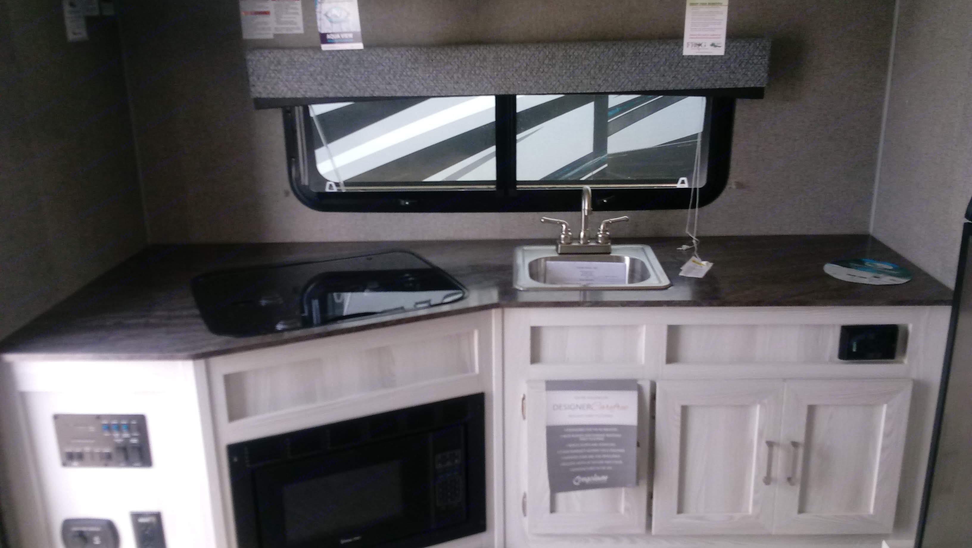 Kitchen with dinette . Jayco Baja 2019