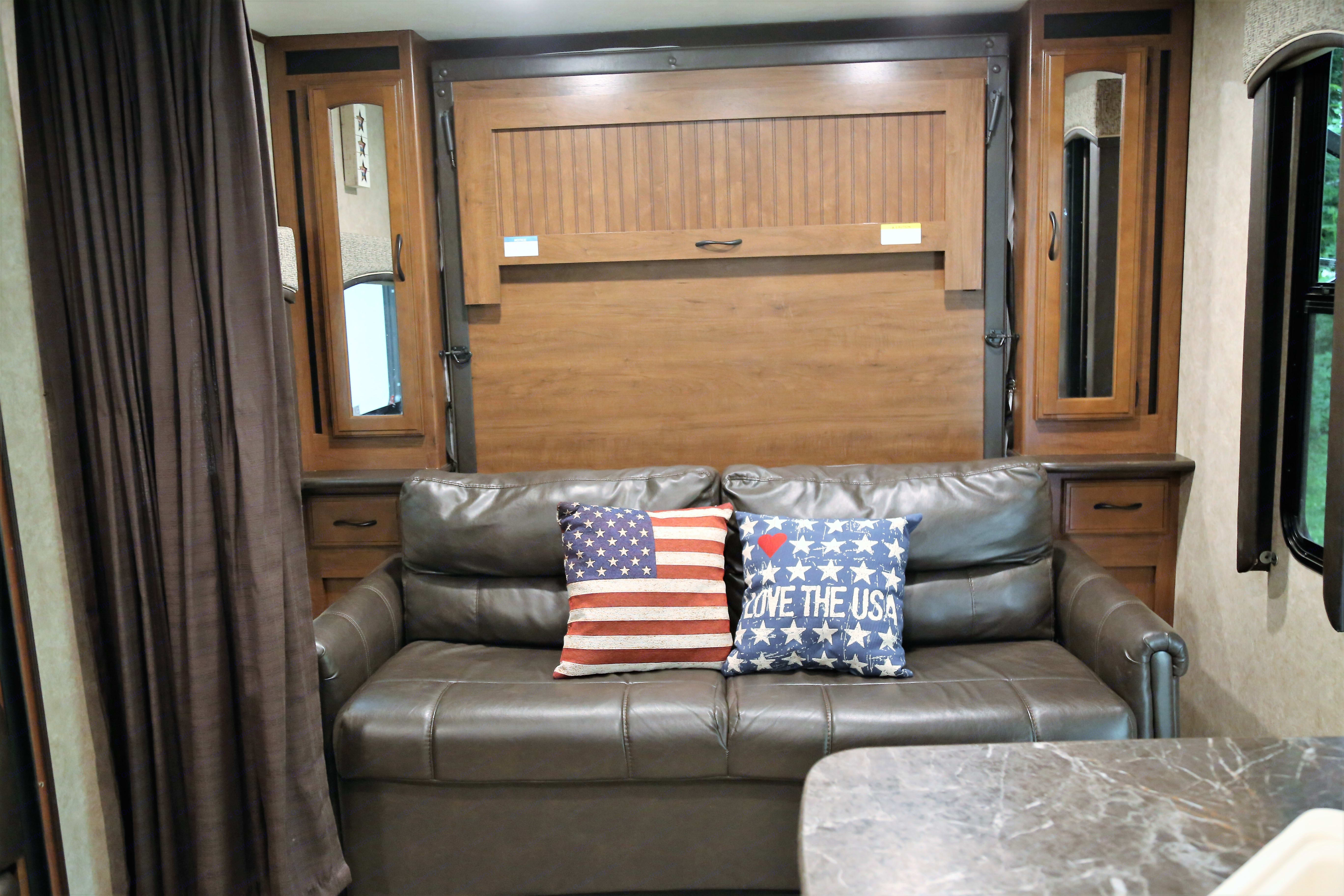 Sofa lays flat to make a bed with side closets and drawers.. Jayco Jay Feather 2016