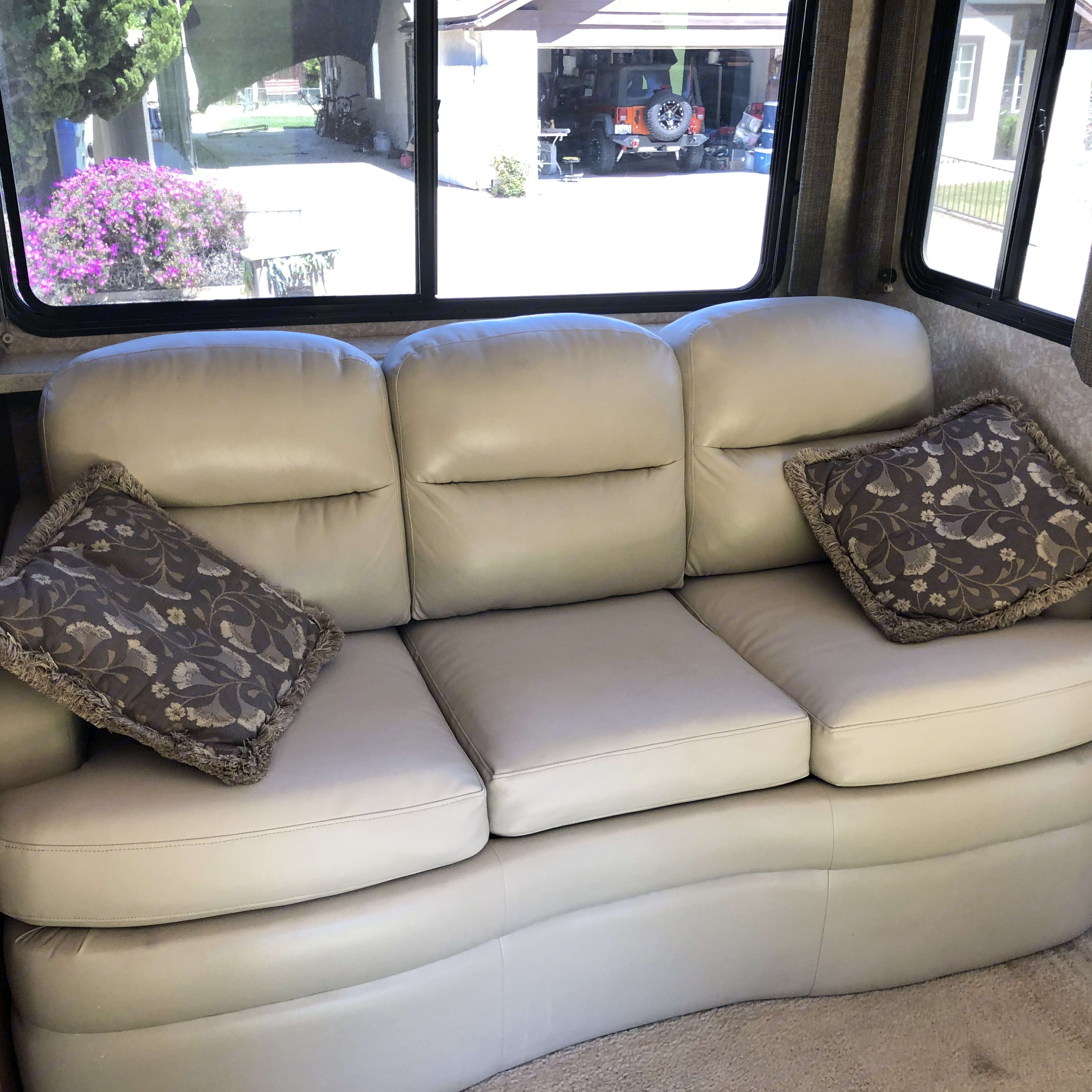 The couch folds out for 2 to sleep. Thor Motor Coach Four Winds 2007