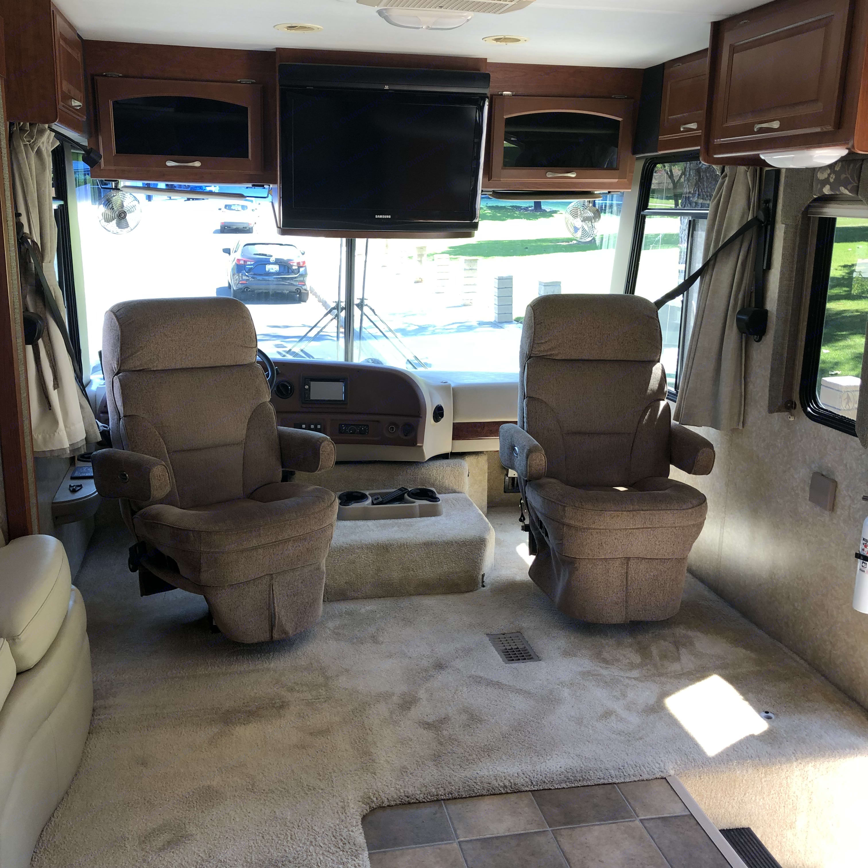 Nice comfortable captain chairs. They move around to so your part of the party. Thor Motor Coach Four Winds 2007