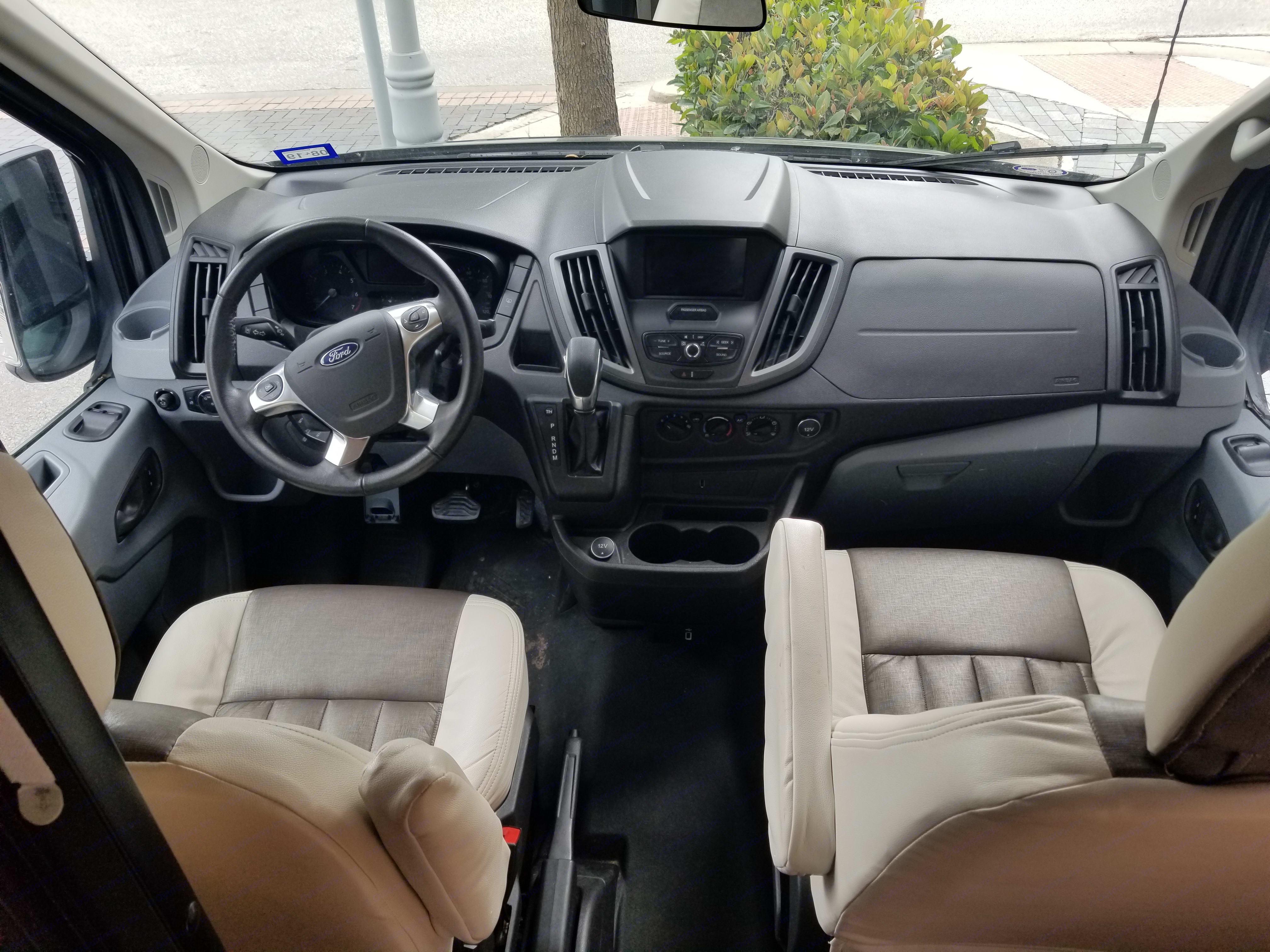 The cockpit.  The passenger seat swivels around.. Winnebago Paseo 2017