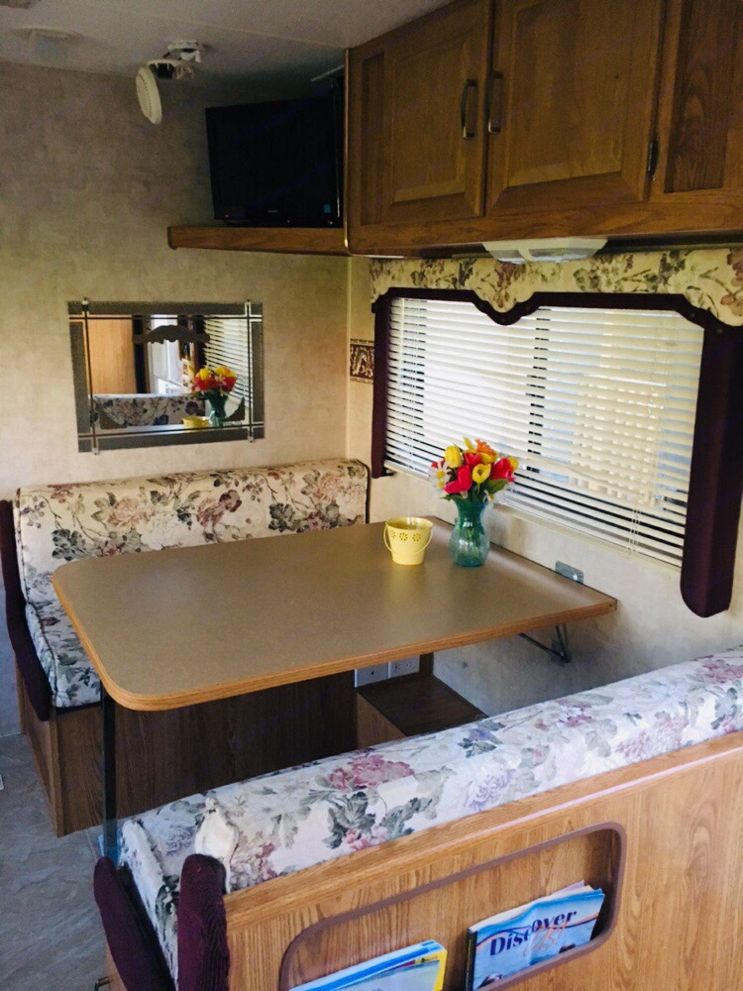 Dining seating and will convert to a double bed for sleeping. Fleetwood Prowler 2006