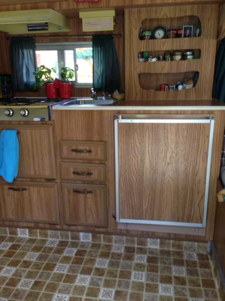 small  propane fridge and three burner propane cook top . Featherlight Trailers Other 1976