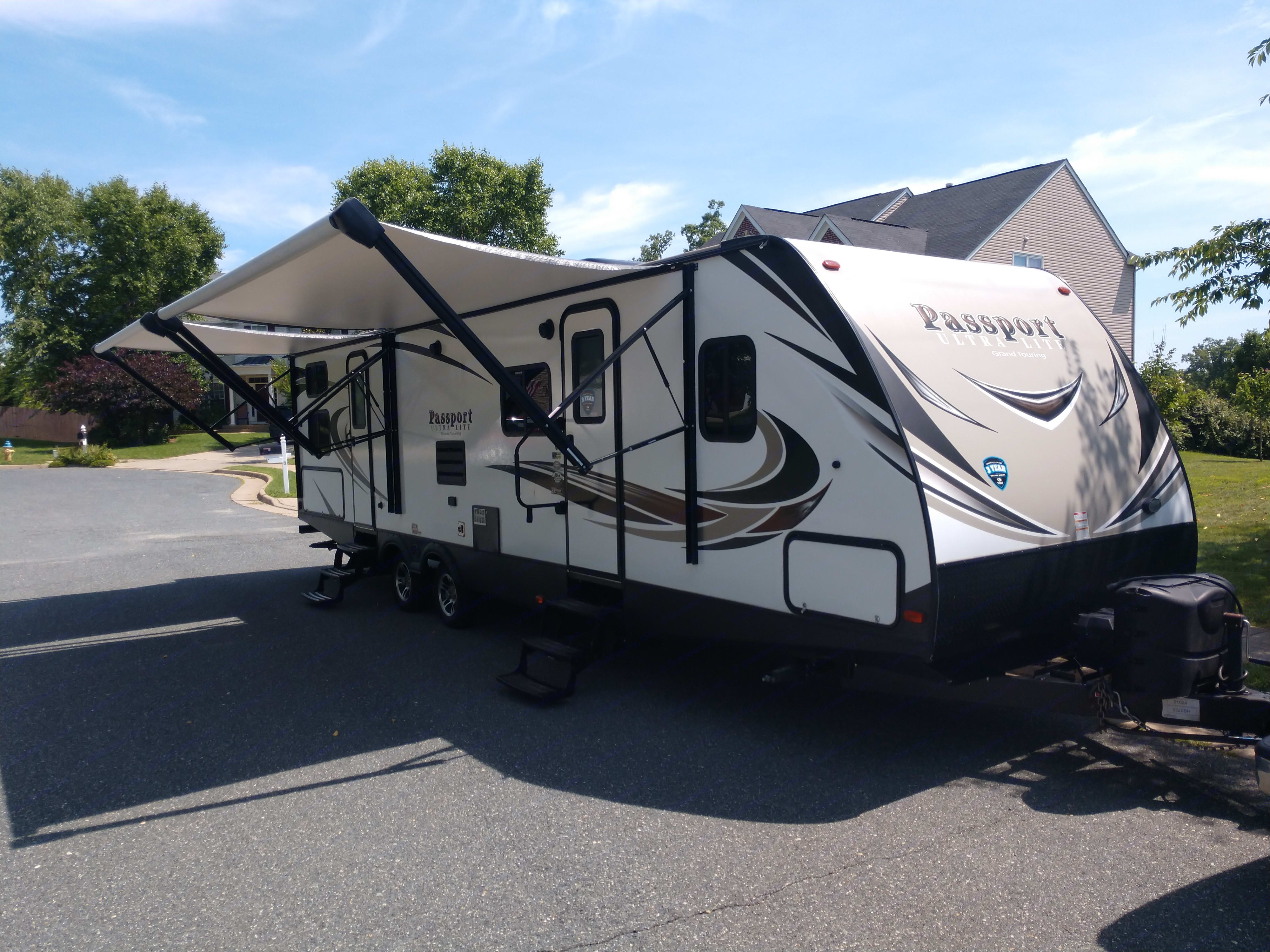 Dual awnings for shade and entries for convenience!  Second door opens up into bathroom for easy outdoor access!. Keystone Passport 2018
