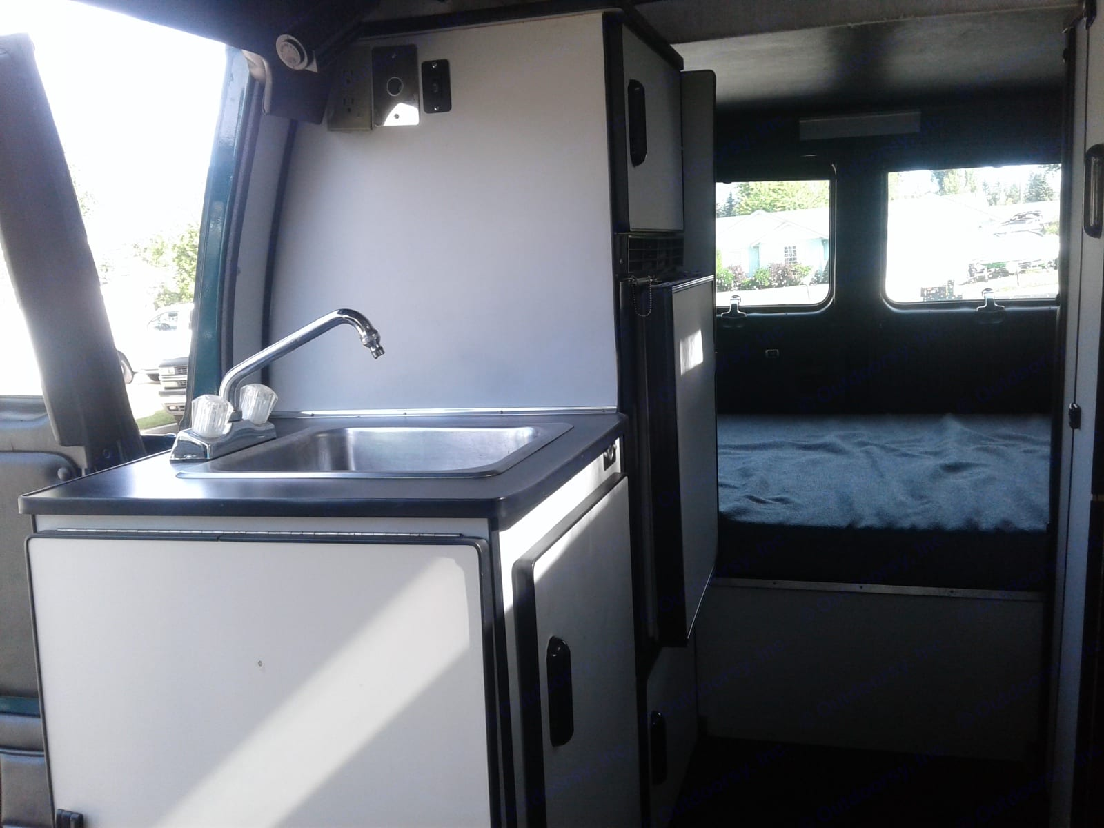 This camper van has (almost) everything, including the kitchen sink.. Gmc Sportsmobile 1994