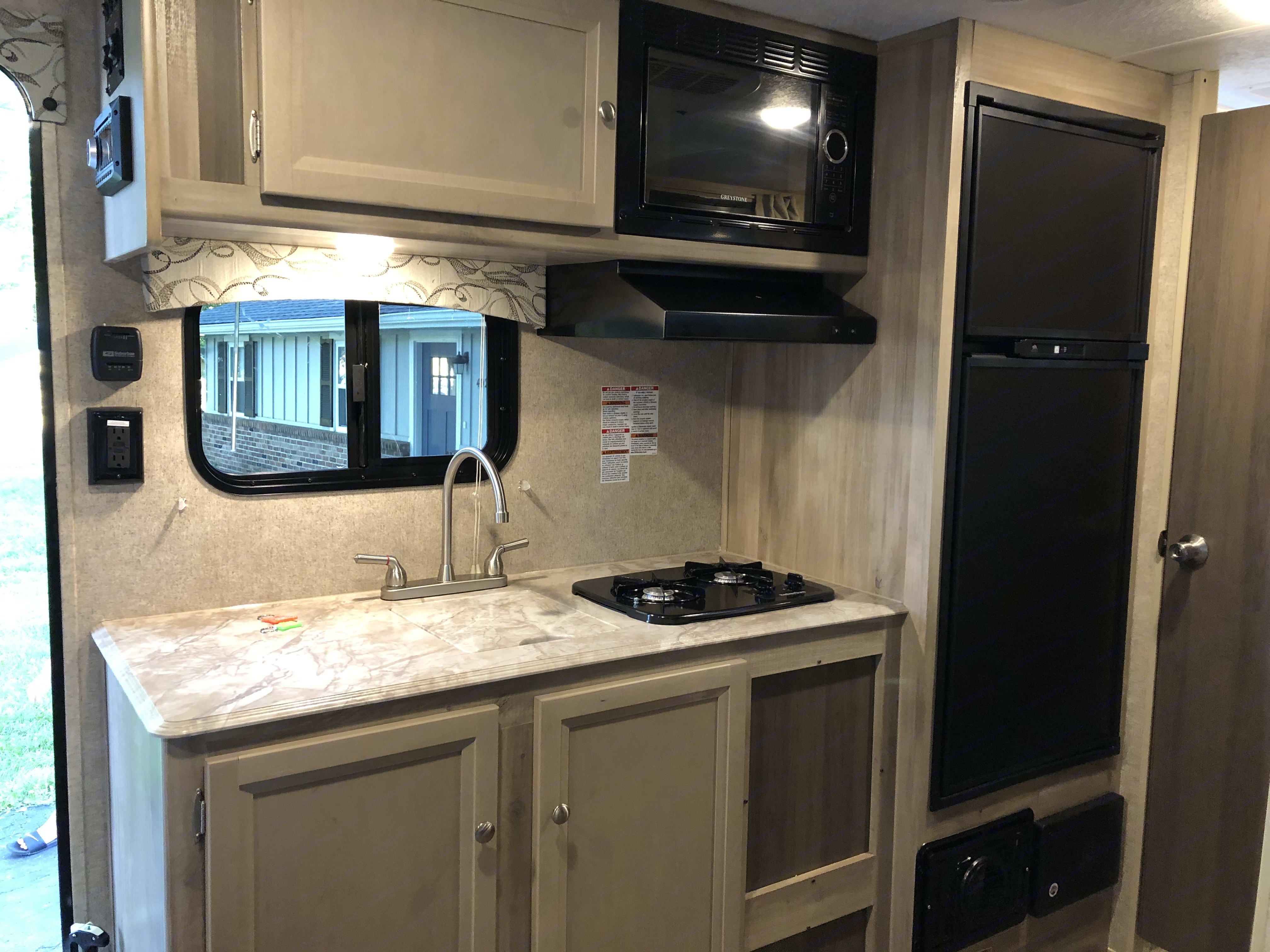 Great size kitchen with full kitchen and freezer. Coachmen Catalina 2020