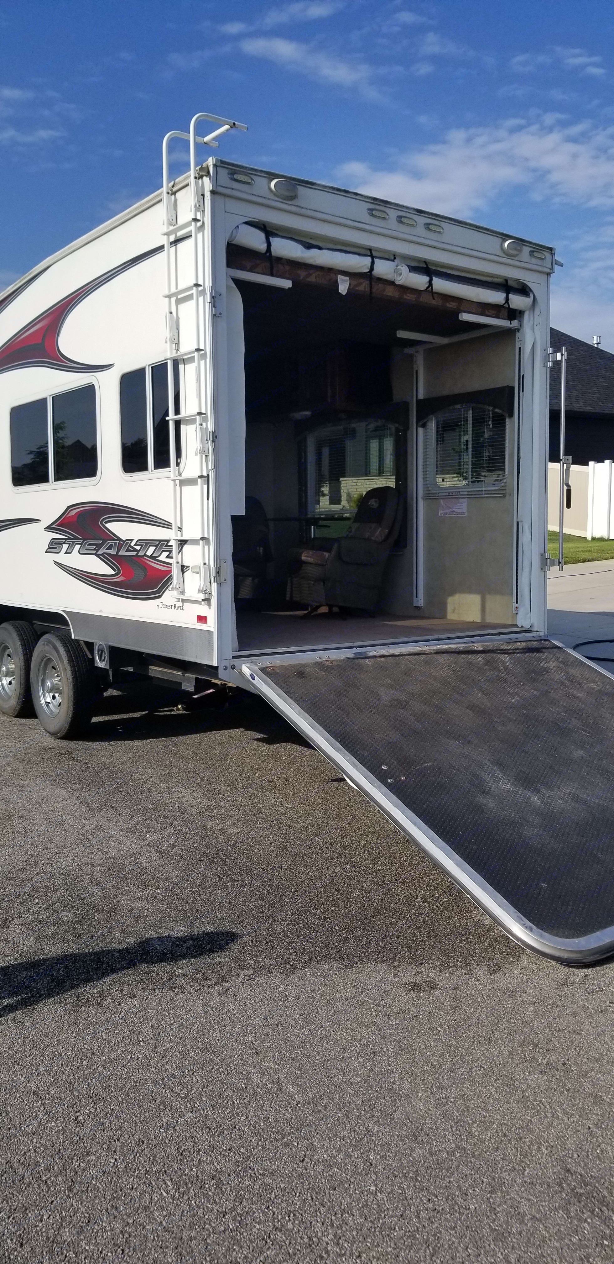 Exterior driver side with ramp lowered.. Forest River Stealth 2013