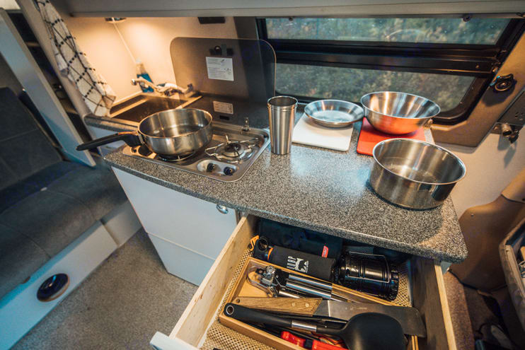 Full kitchen with everything you'll need to make some amazing meals. Comes with stove, sink, water, fridge and storage.. Ford Econoline 2008