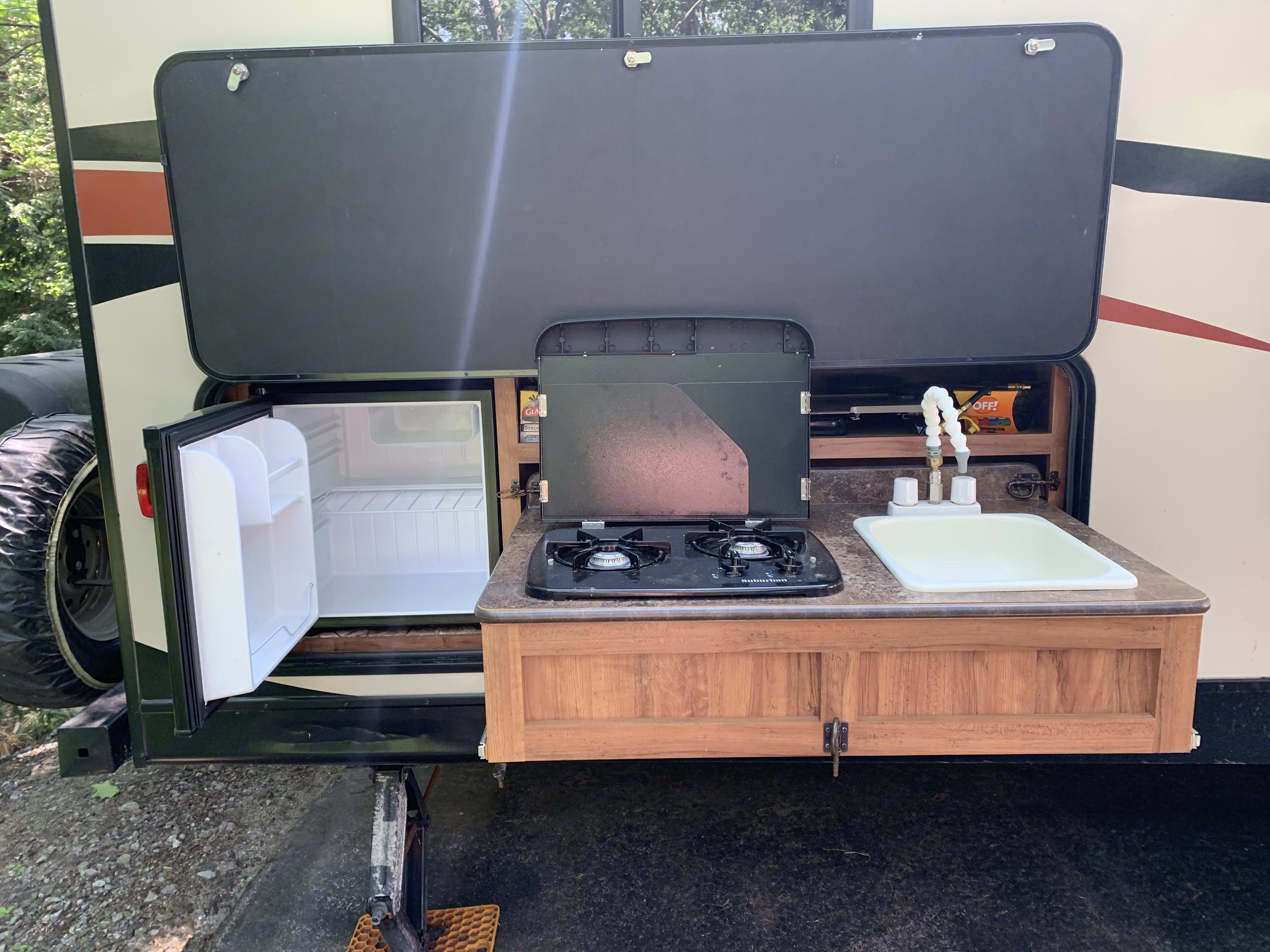 Exterior kitchen and stand alone propane grill for your outdoor dining experience. We have everything you need to prepare and serve every meal of the day!. K-Z Manufacturing Spree 2015