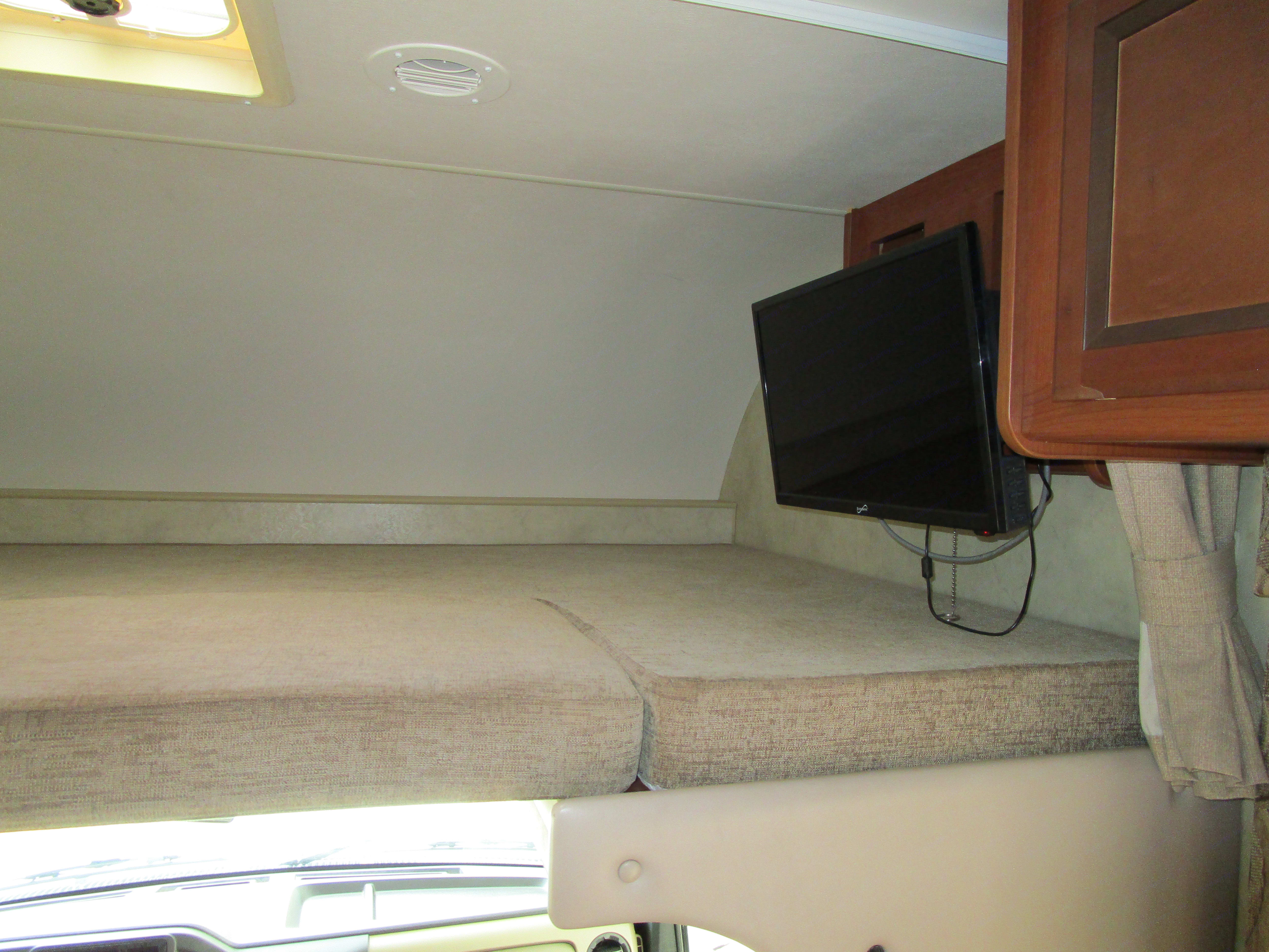 Overhead sleeping compartment with privacy curtain - TV/DVD nearby.. Thor Motor Coach Four Winds 2013