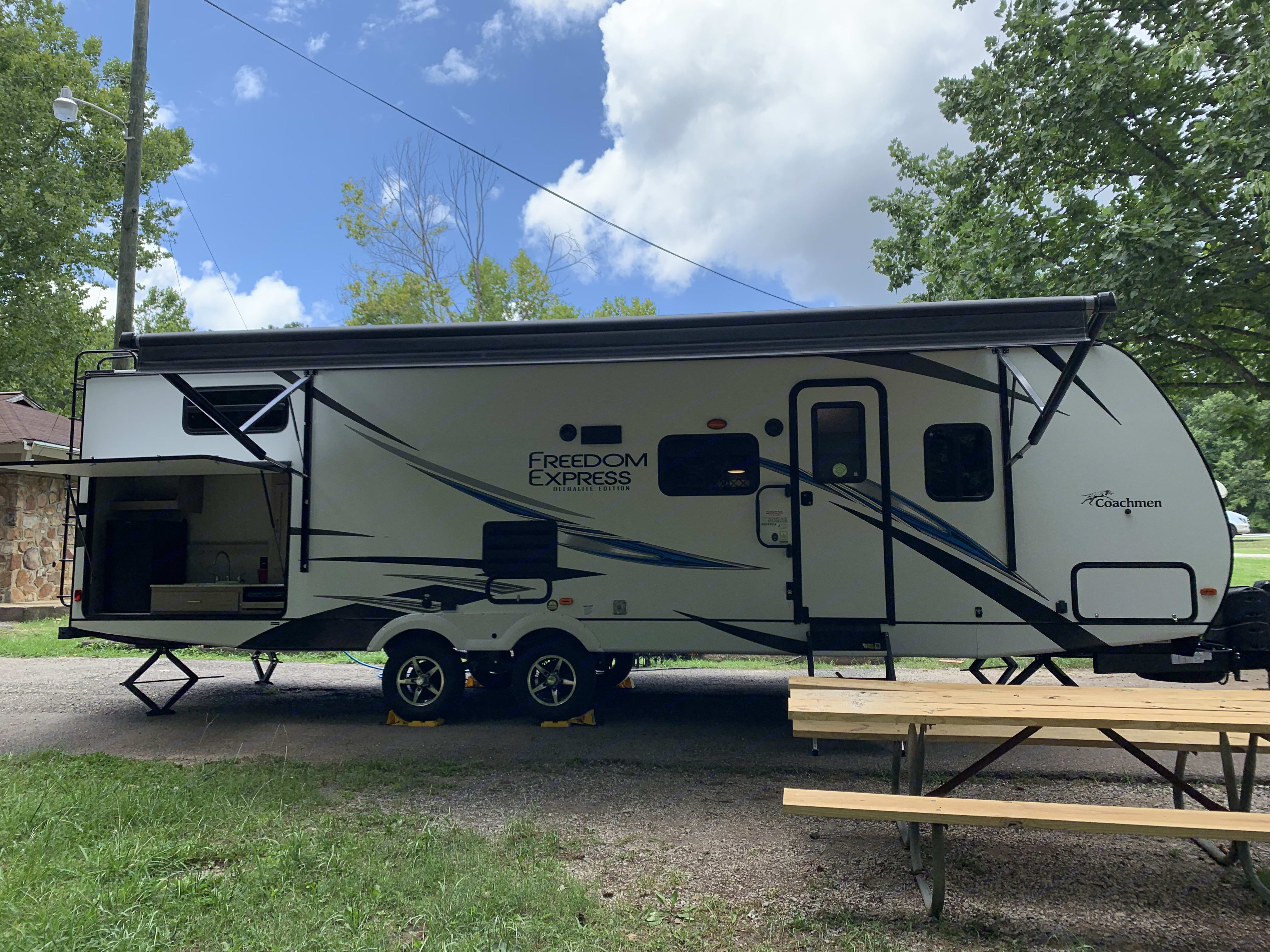 Plenty of space to hang out under the awning and around the outdoor kitchen.. Coachmen Freedom Express 2020