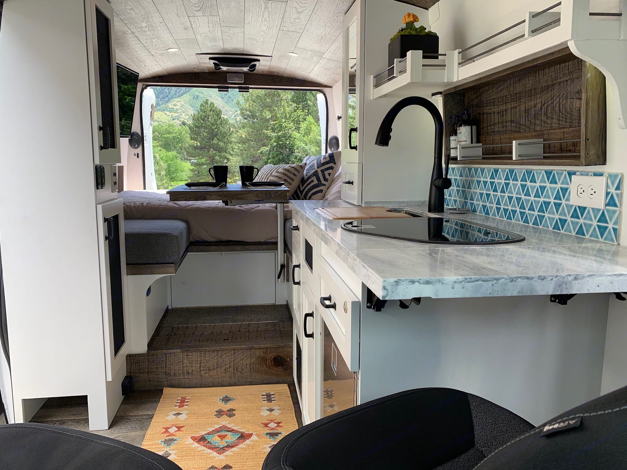"""View of the van from the front swivel seats. The bed is currently in the """"full"""" configuration, but can be converted to a king (as seen in the following pics). Custom Other 2019"""