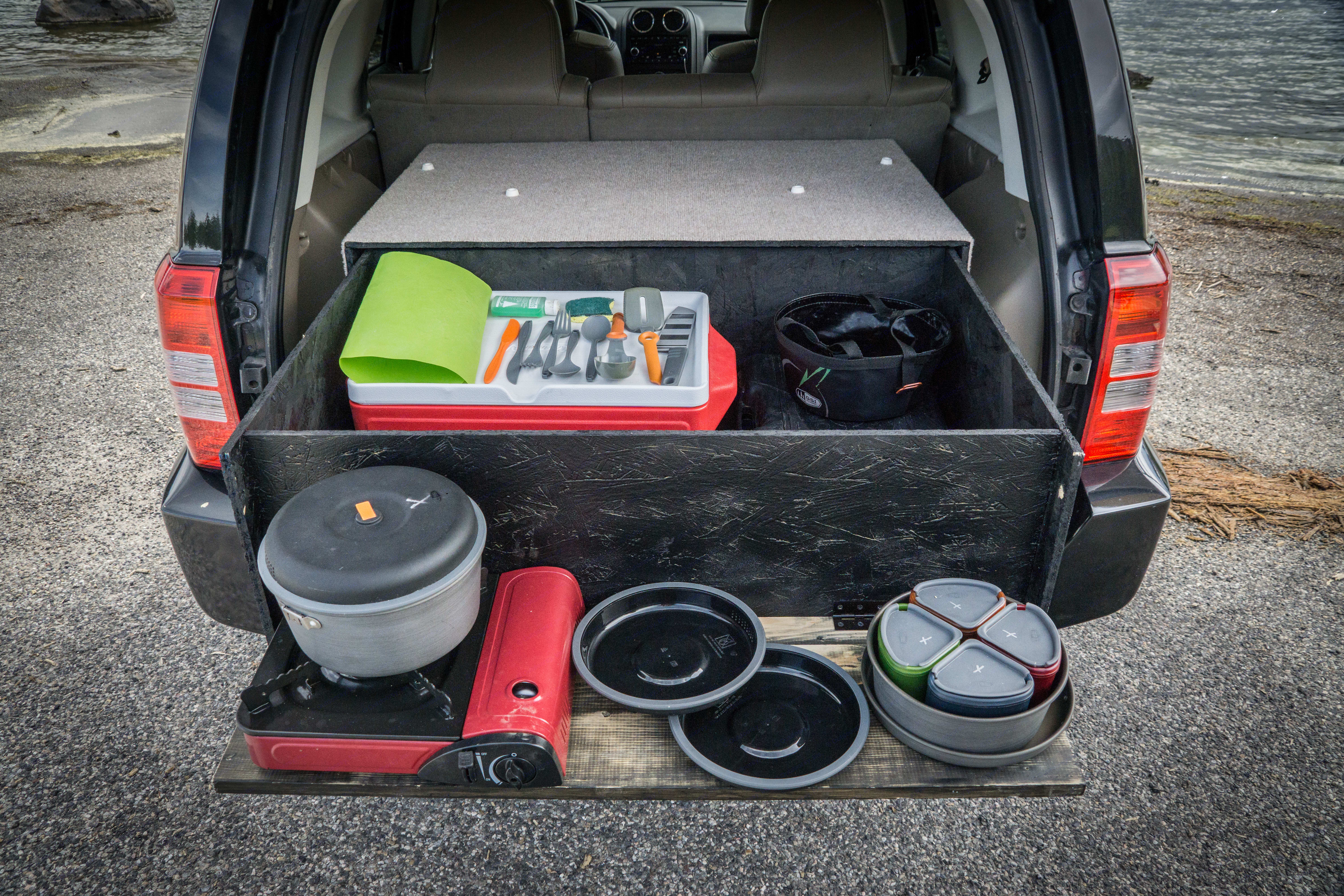 Pull out gear box with a fold down cooking station. All the necessities for a country side cook out. . Jeep Patriot 2009