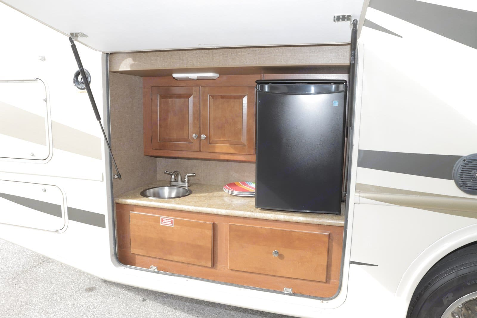 Outdoor Kitchen with sink and refrigerator for the great outdoors as well as tailgating.. Thor Motor Coach Windsport 2015
