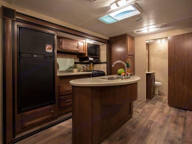 Kitchen with island . Dutchmen Aspen Trail 2015