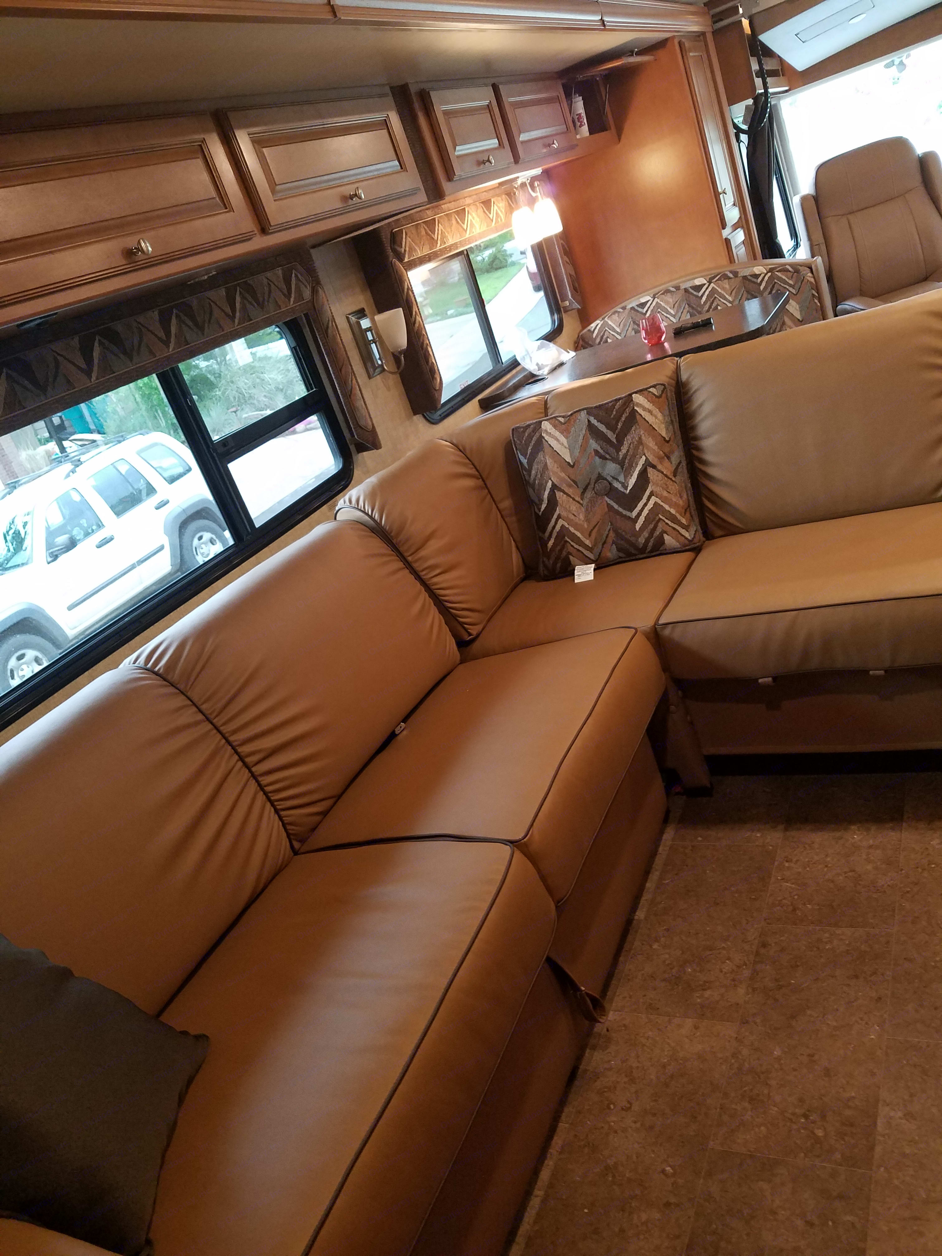 The lounge by the interior fireplace and main TV. Winnebago Vista 2017