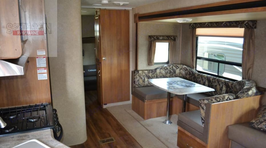 Dining table and door to bunkhouse . Coachmen Catalina 2017