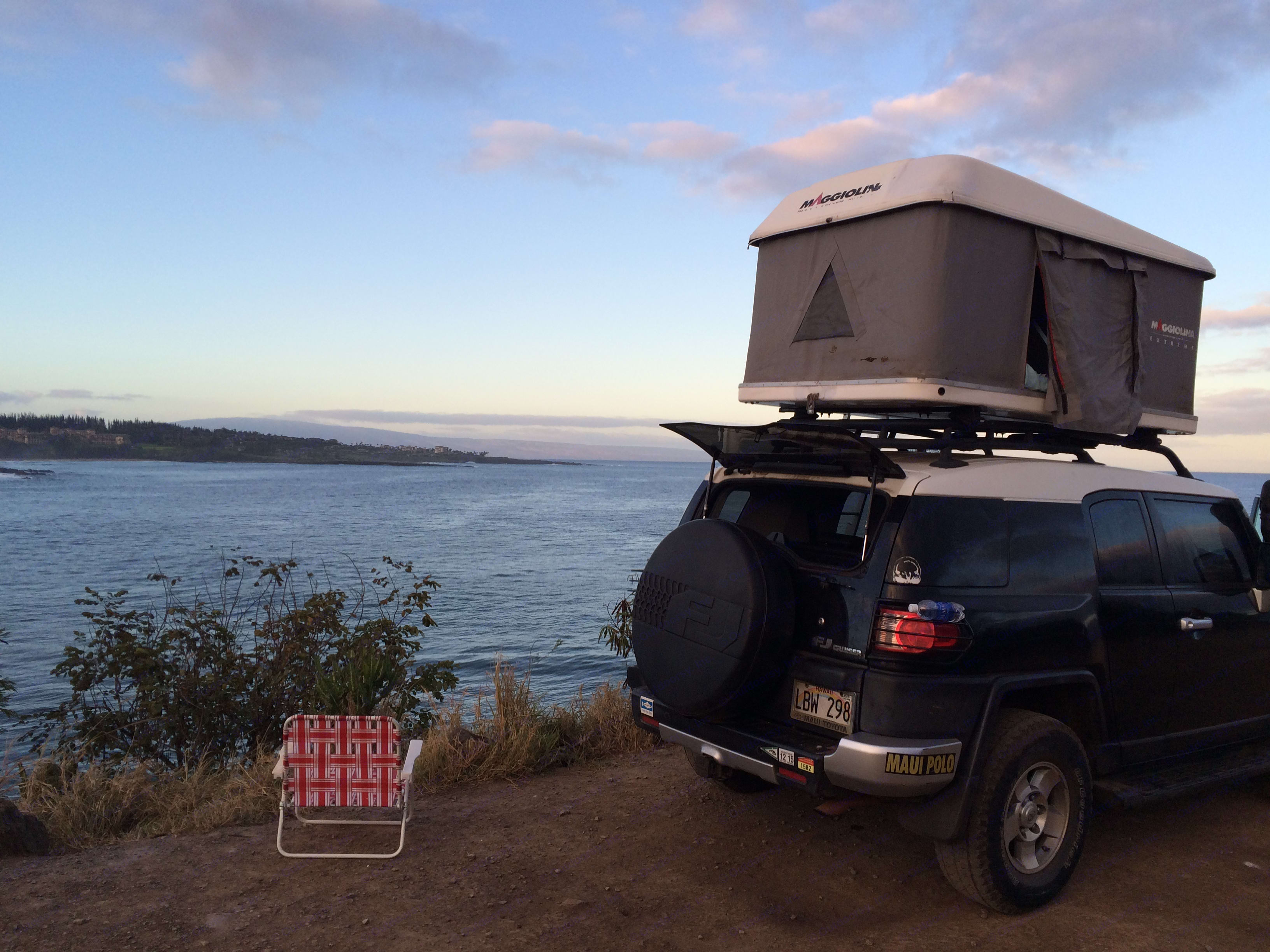 Easy to store surfboard and travel gear.  Room top is solid quality for all weather and easy to pop up, you don't need even surface to swing a tent to be secure, this tent pops up vertical. Toyota FJ Cruiser 2008