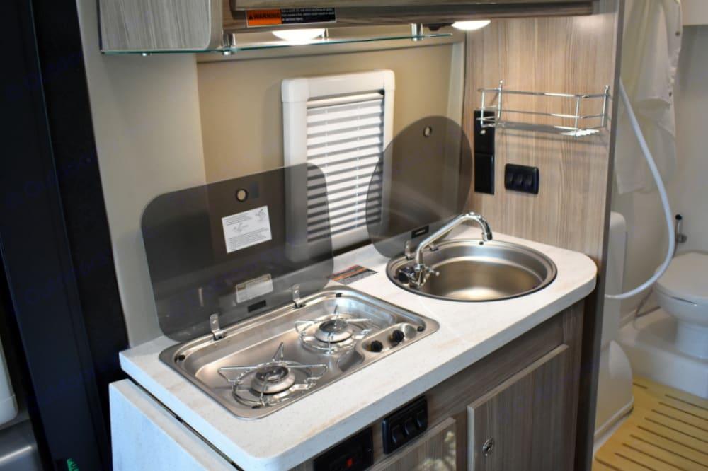 Kitchen cooktop and sink. Winnebago Travato 2020