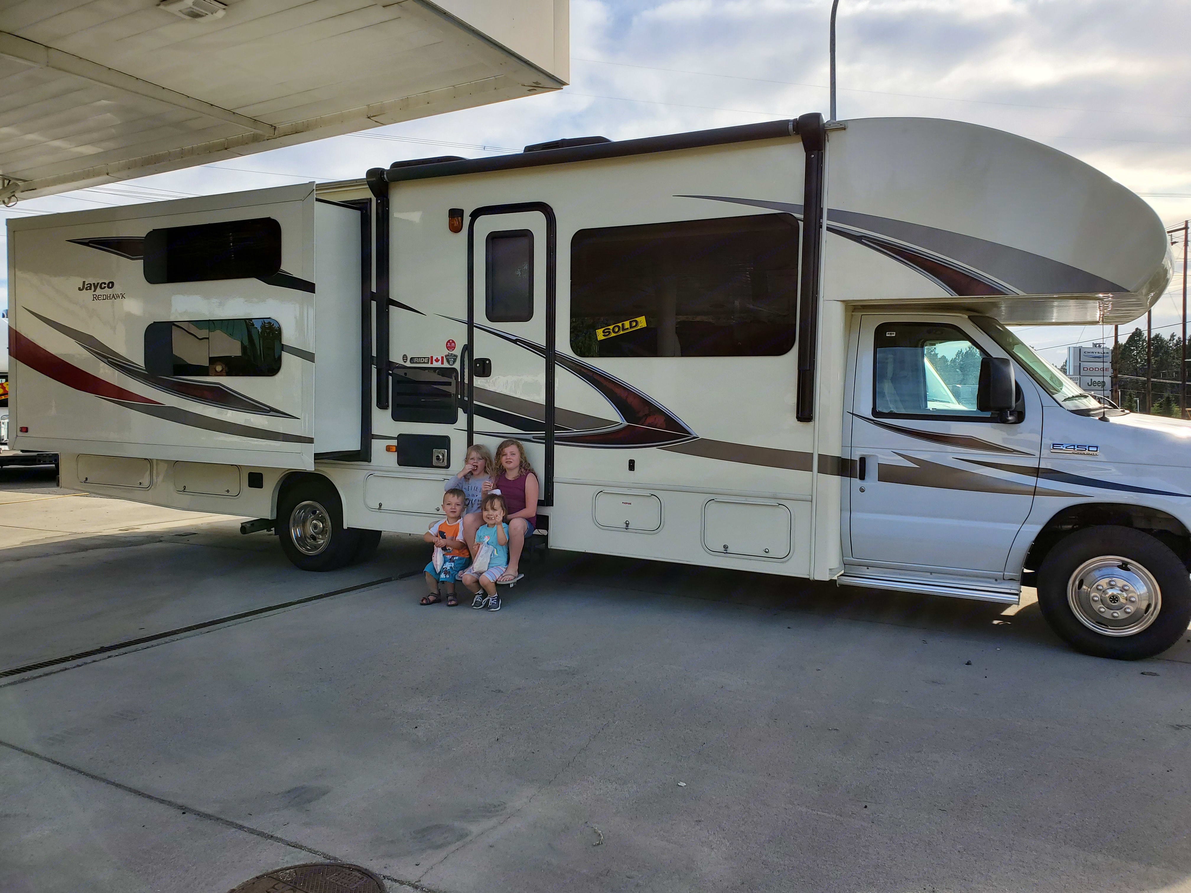 A picture of the day we made a family dream come true. We have four young kids and the RV life makes traveling enjoyable. We are excited to share our home on wheels with you on your next family adventure!. Jayco Redhawk 2017