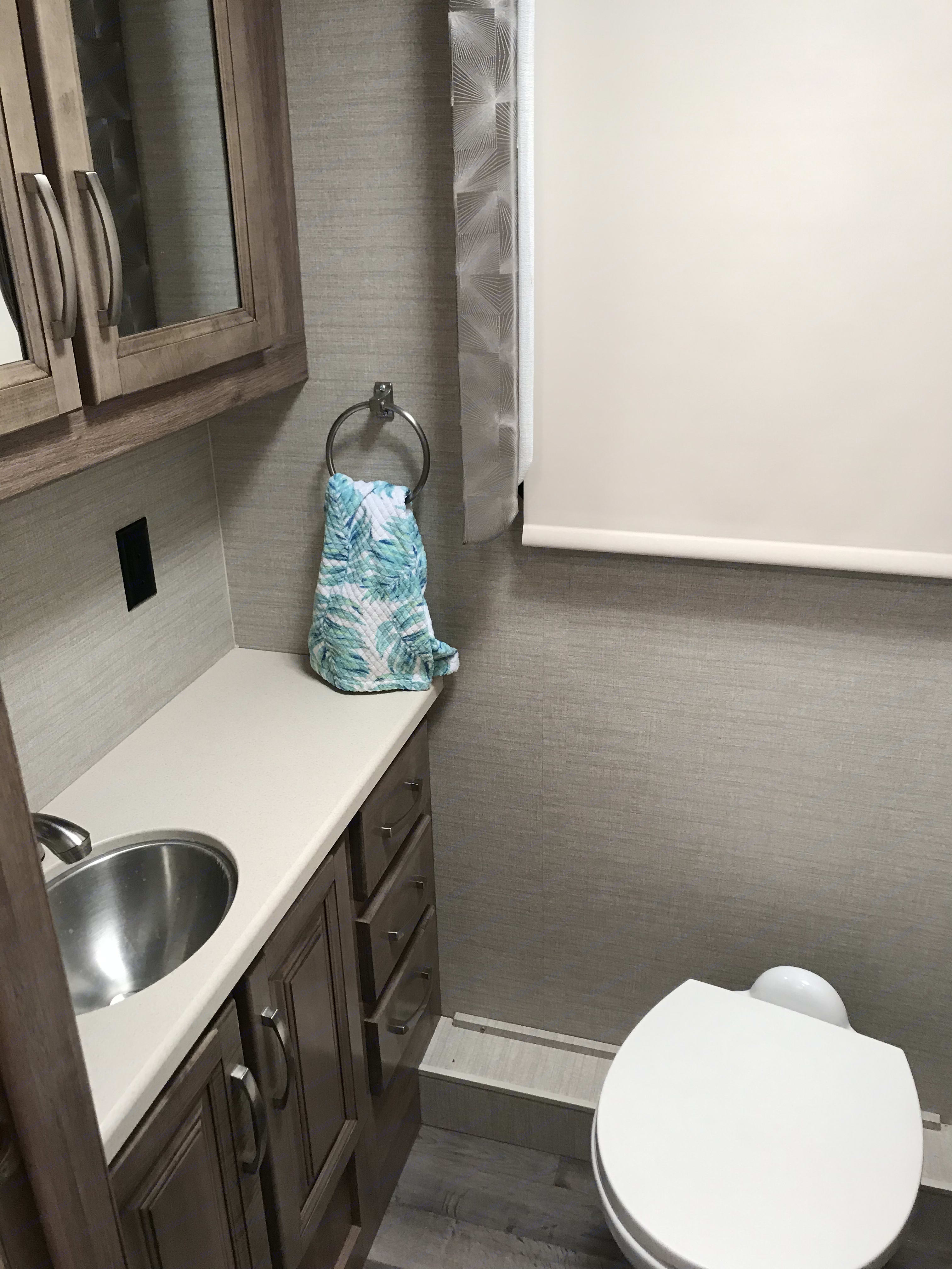 Separate spacious bathroom area with sizable counter, cabinets, storage, etc. . Jayco Precept 2020