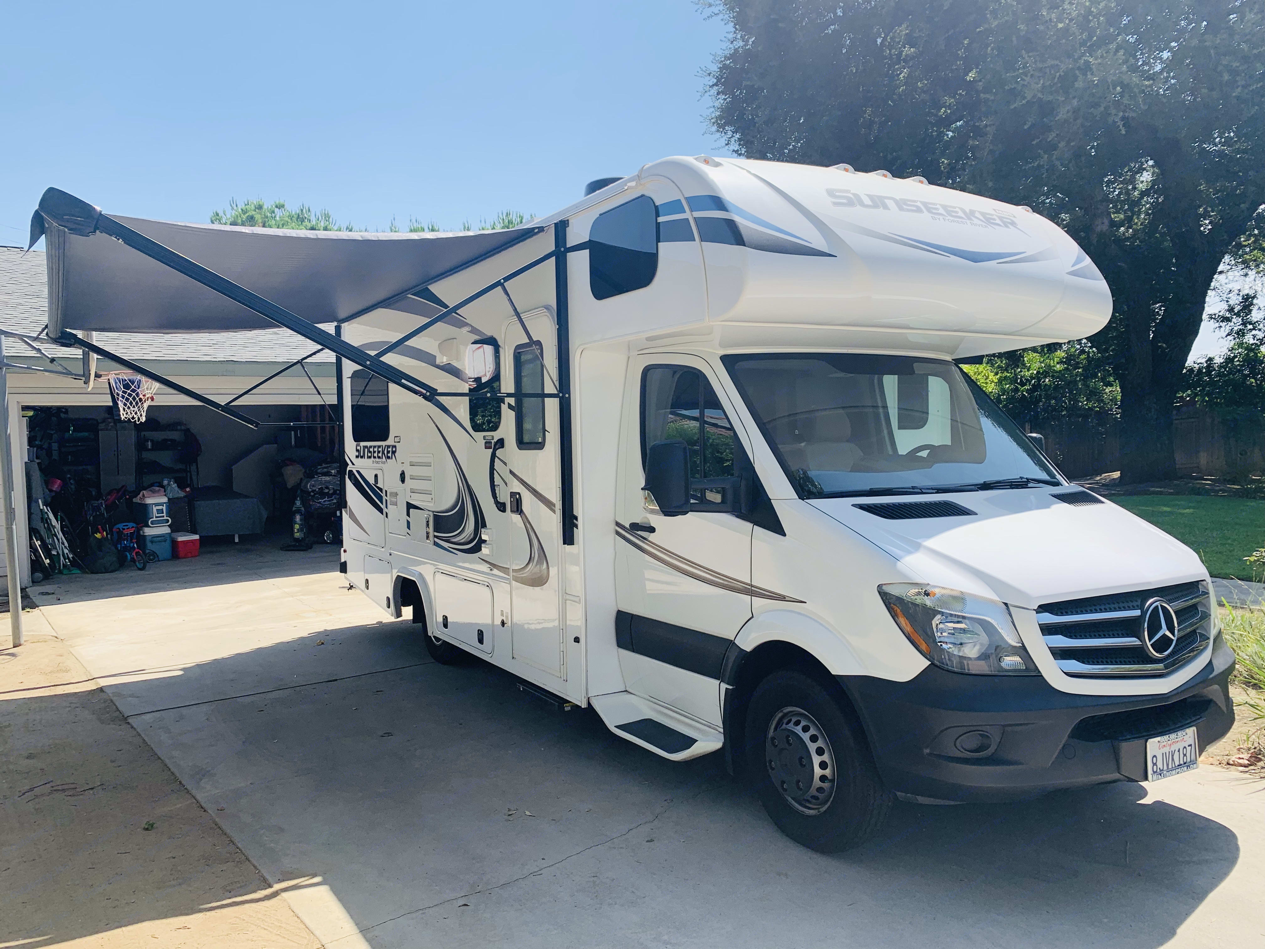 Patio awning with Solar- powered RV novelty lights and speakers, to create an extra living space when you want to experience nature fully.. Forest River Sunseeker 2019