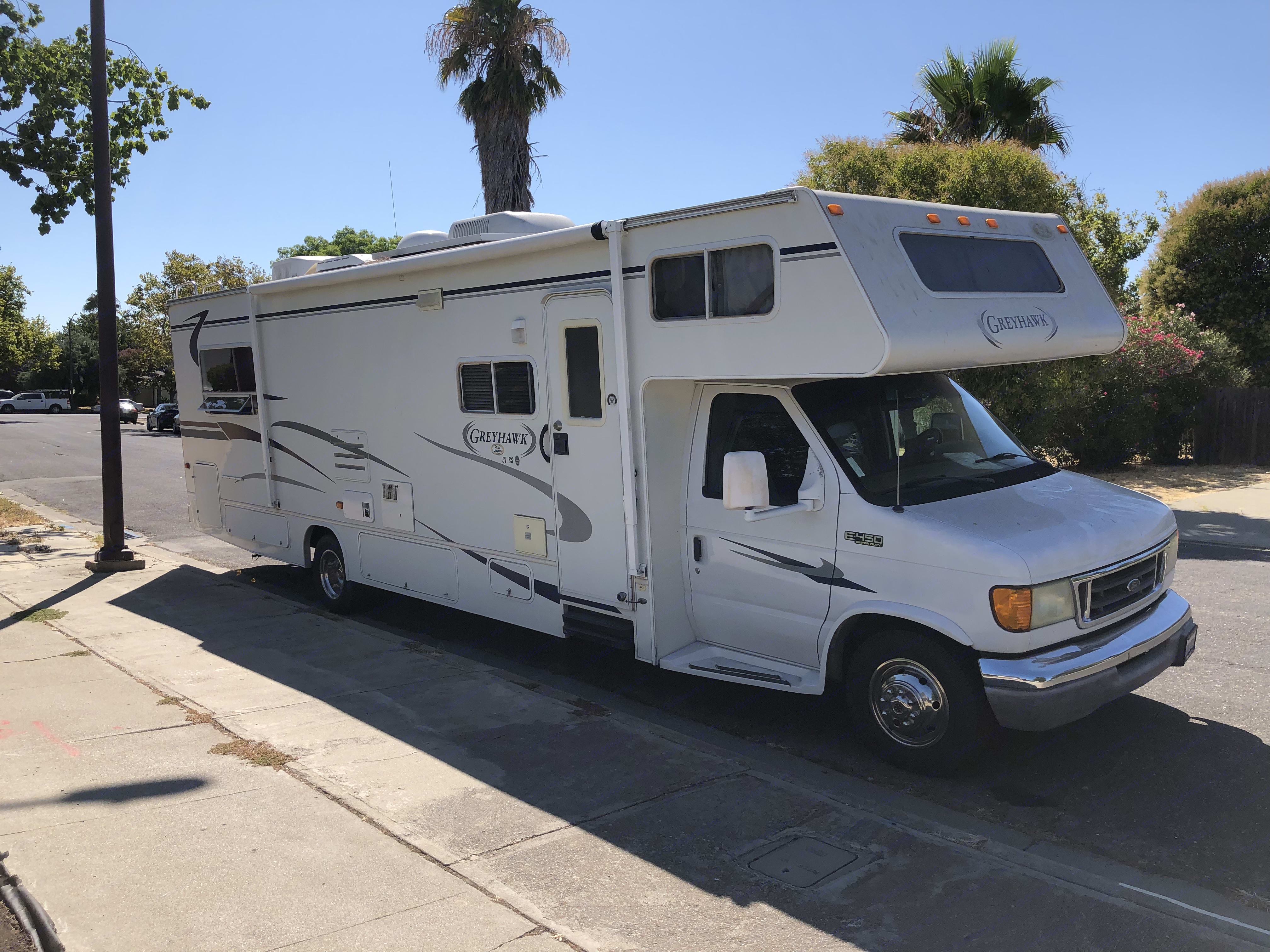 Ready to roll! There is a roll out awning on this side for extra shade. Jayco Greyhawk 2004