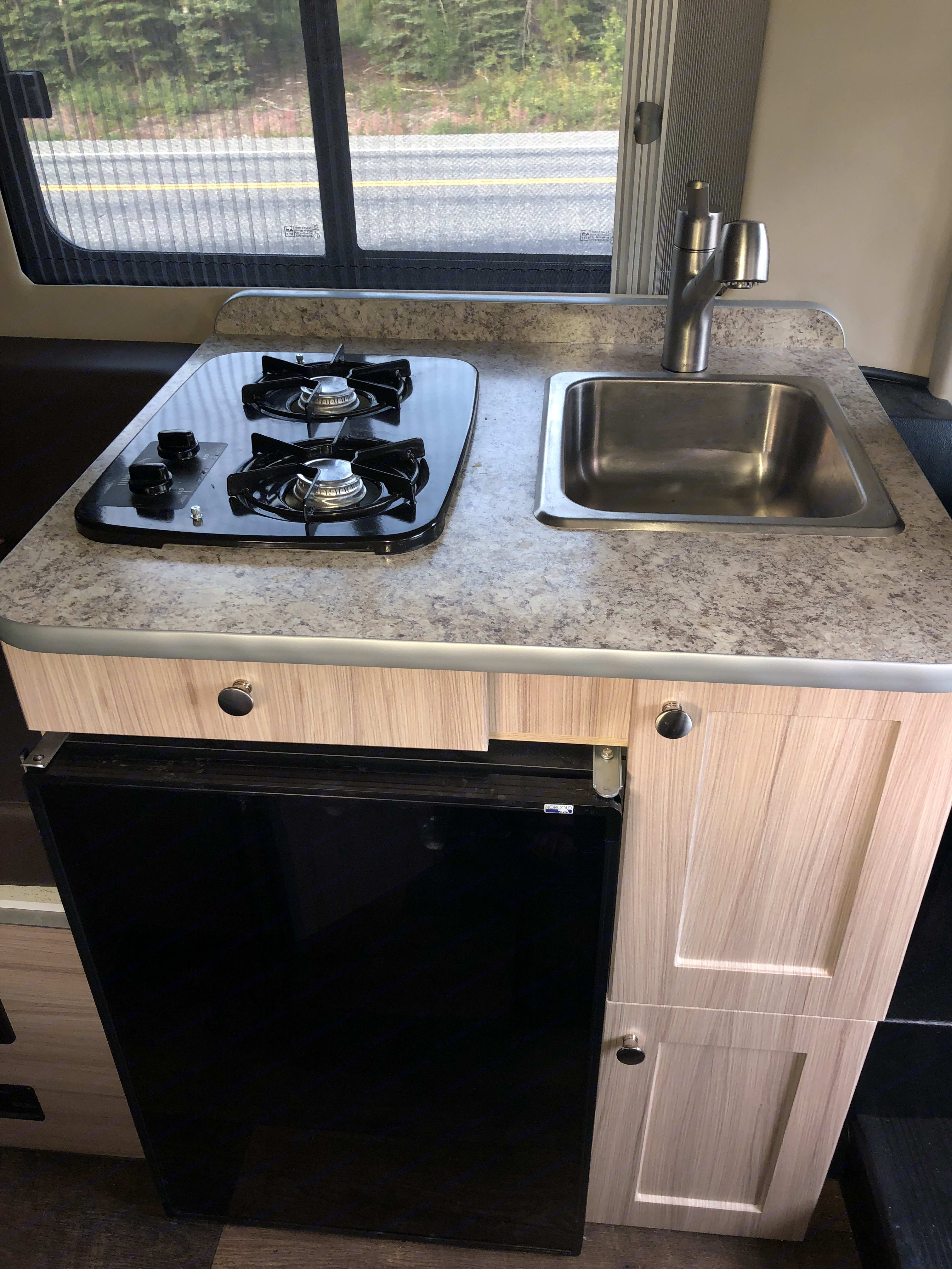2 burner stove, sink, fridge , and microwave make it easy for one to cook a delicious meal on the road.. Dodge Sunlight 2018