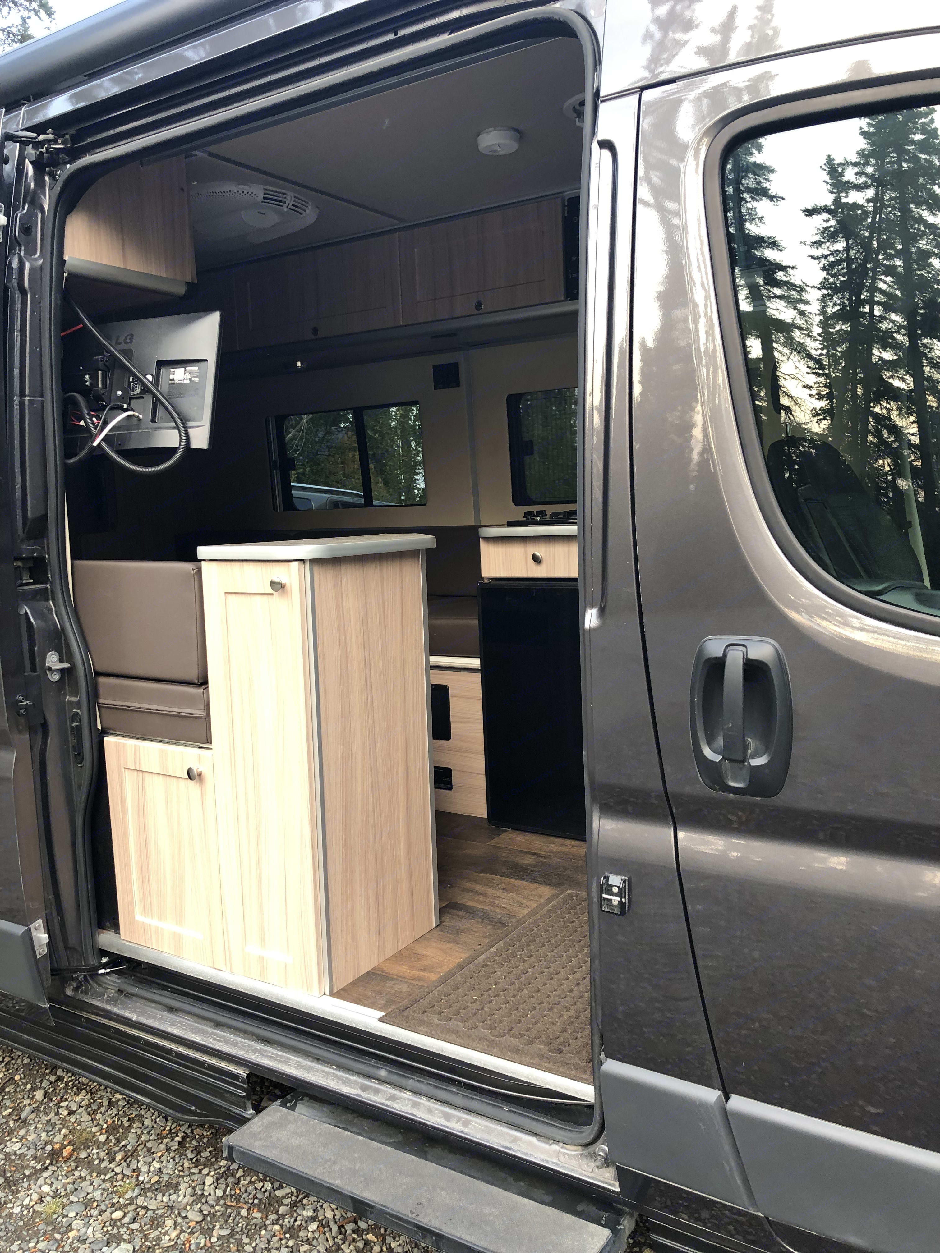 """Ample storage  located underneath and over top of  the bed with a tv! ... completes the needs of """"glamping"""".. Dodge Sunlight 2018"""