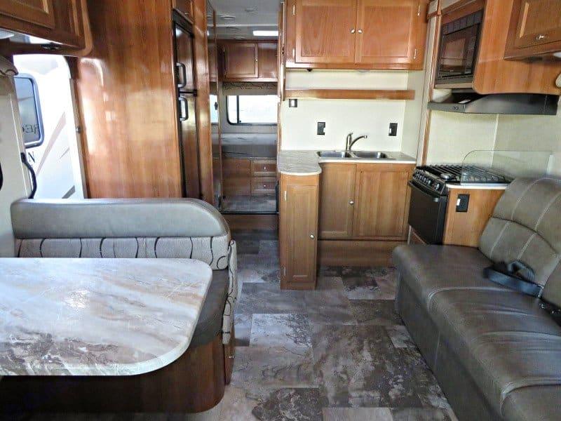 Refrigerator, freezer, stove, oven, and microwave.. Coachmen Leprechaun 2019