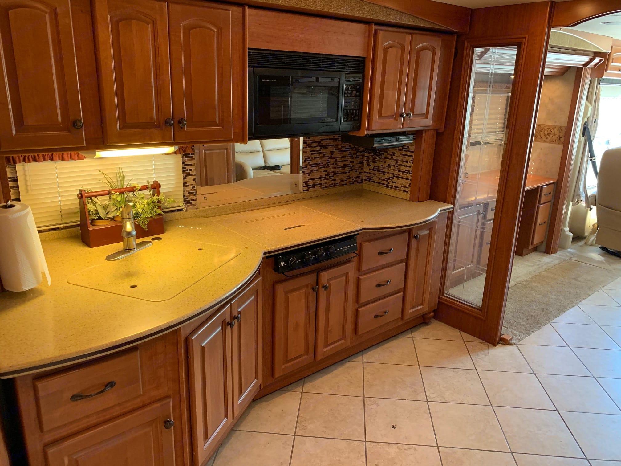 Kitchen includes microwave, range and plenty of storage . Damon Tuscany 2008