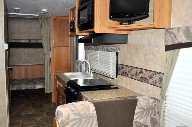 Kitchen / bunk beds in back of picture. Jayco Jay Feather Exp 2009