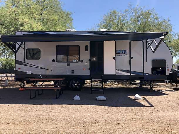 Front with fully extended awning.. Forest River Vengeance 2019