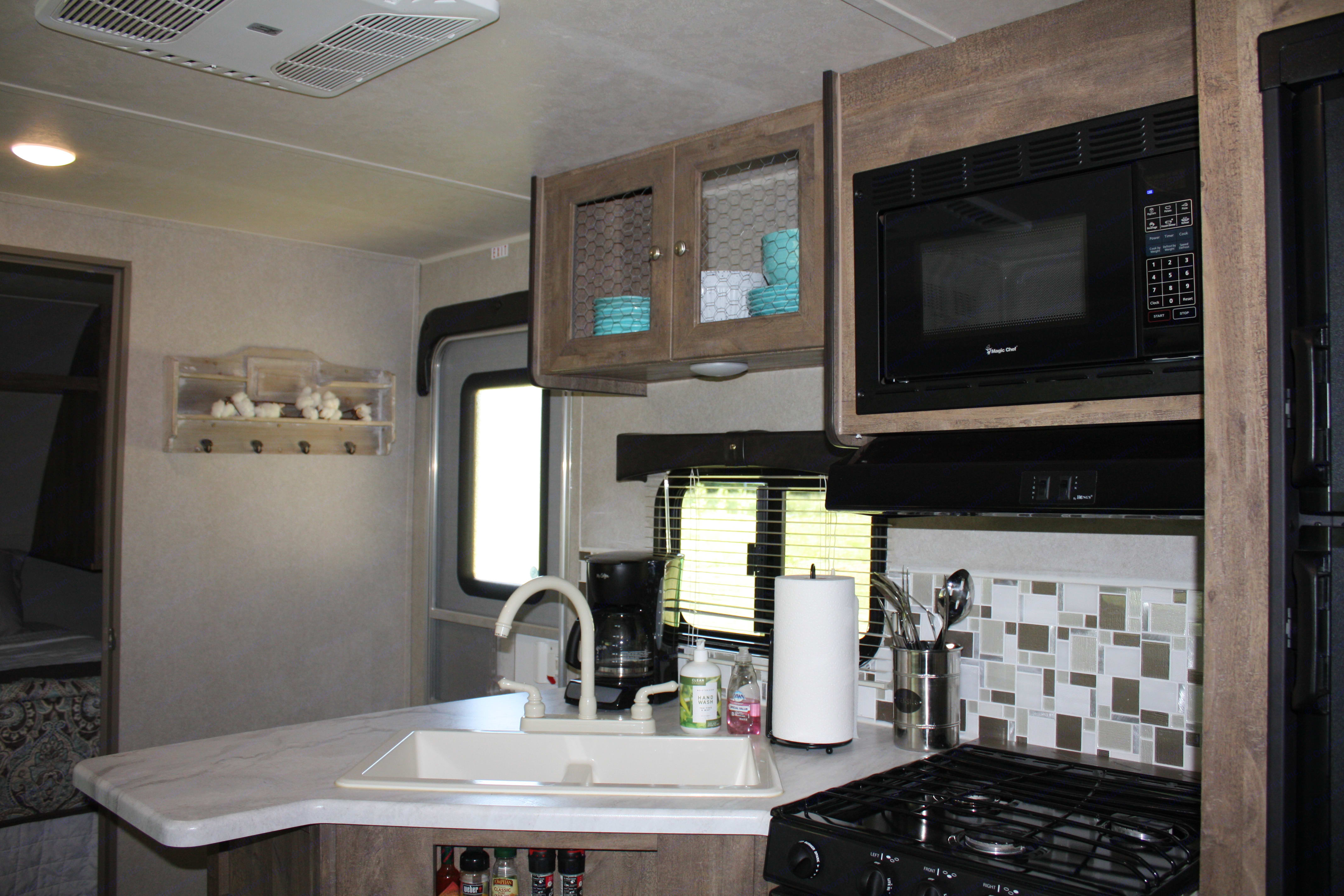 Fully equipped kitchen with Refrigerator, Microwave, coffee maker and . Forest River Puma 2018