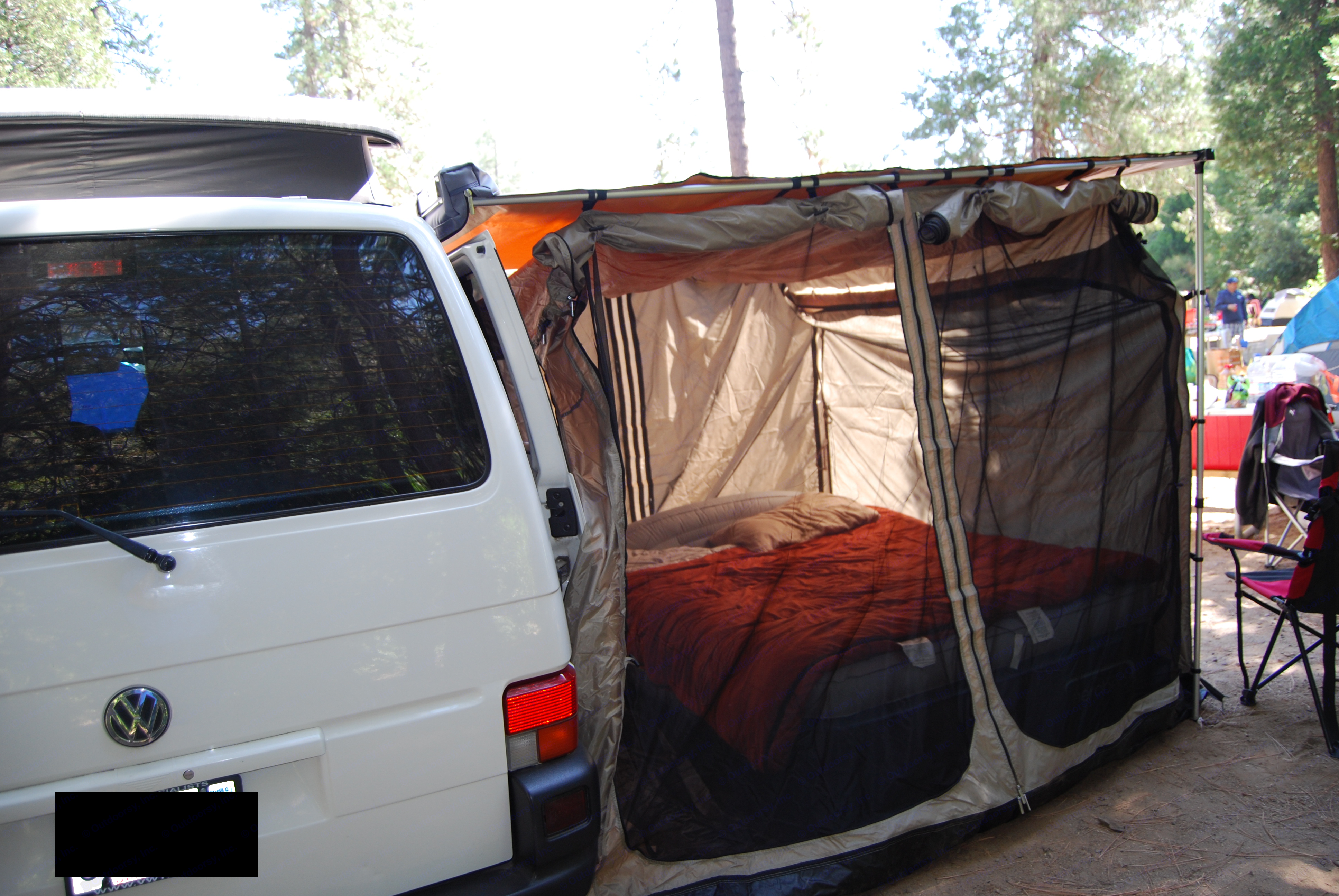Fully enclosed awning room is spacious enough for a queen-sized air mattress and side flaps roll up to let in fresh air but screens keep pesky insects out.. Volkswagen T4 Multivan Westfalia 2002