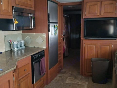 Very spacious kitchen and living room with 2 big screen TV with surround sounds.. Forest River Georgetown 2011